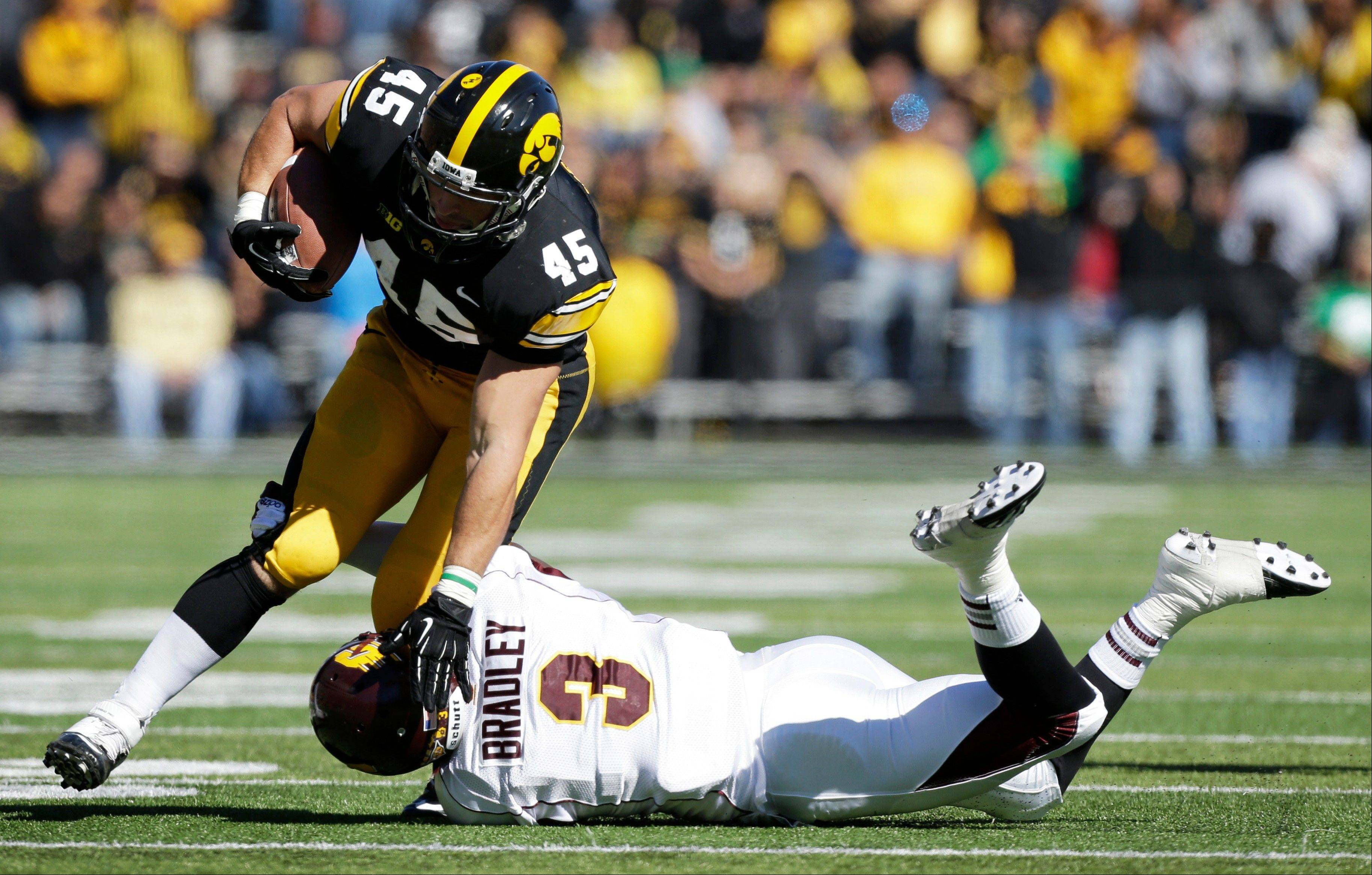 Iowa fullback Mark Weisman tries to break a tackle by Central Michigan defensive back Taylor Bradley during last Saturday's game in Iowa City. The 2-2 Hawkeyes play 4-0 Minnesota at home today.