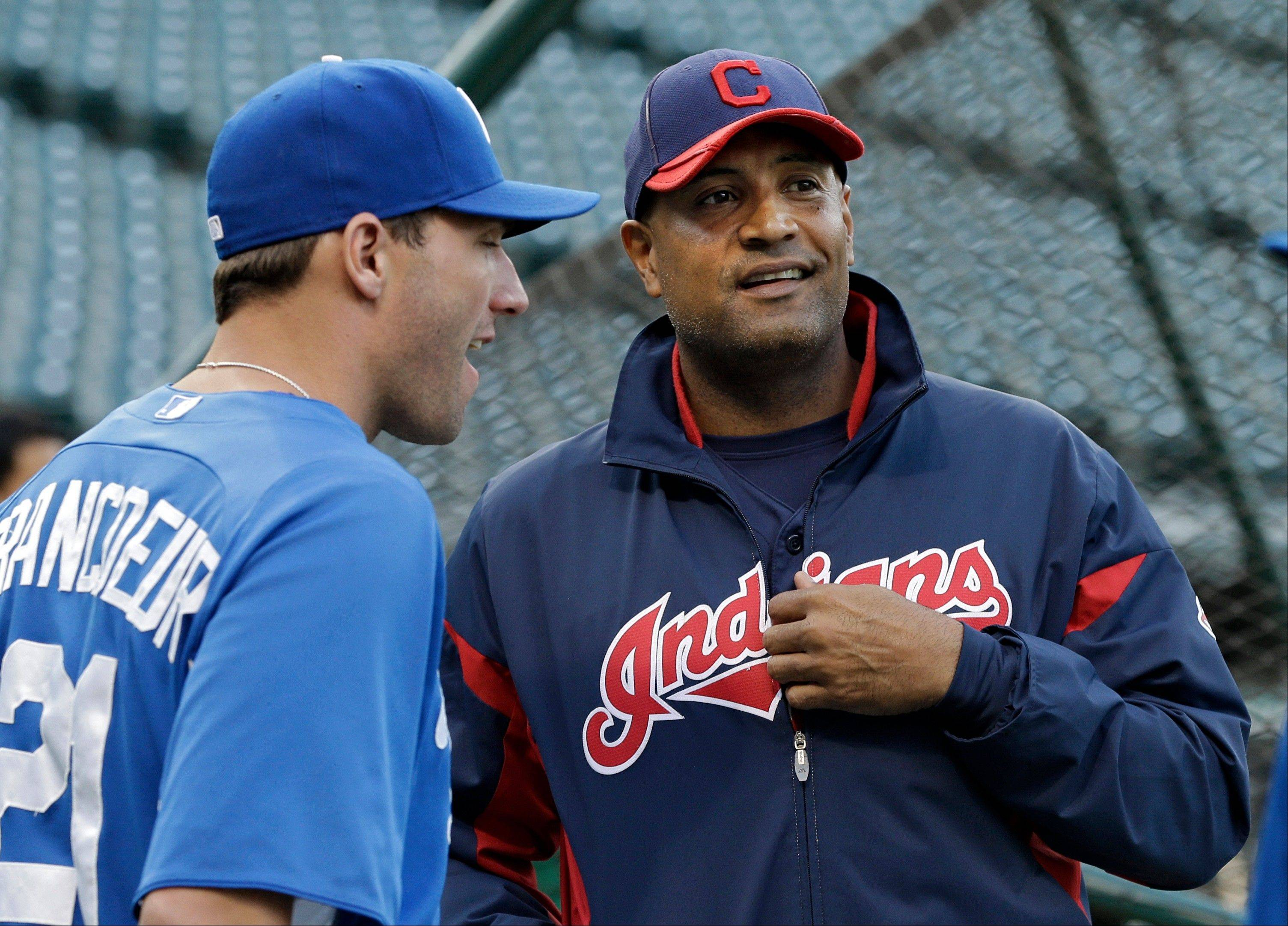 Indians interim manager Sandy Alomar Jr. talks with Royals right fielder Jeff Francoeur during batting practice before Friday's game in Cleveland.