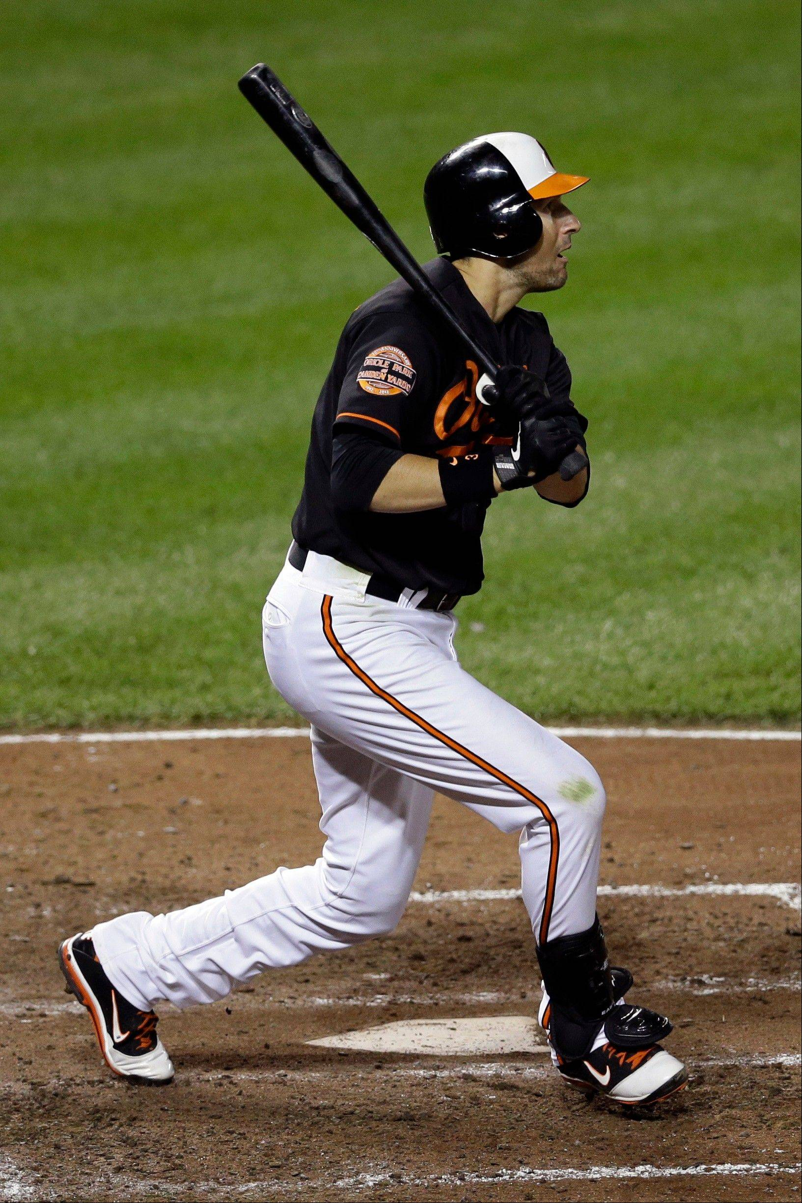 Baltimore's Ryan Flaherty doubles in the fifth inning Friday at home against the Boston Red Sox.