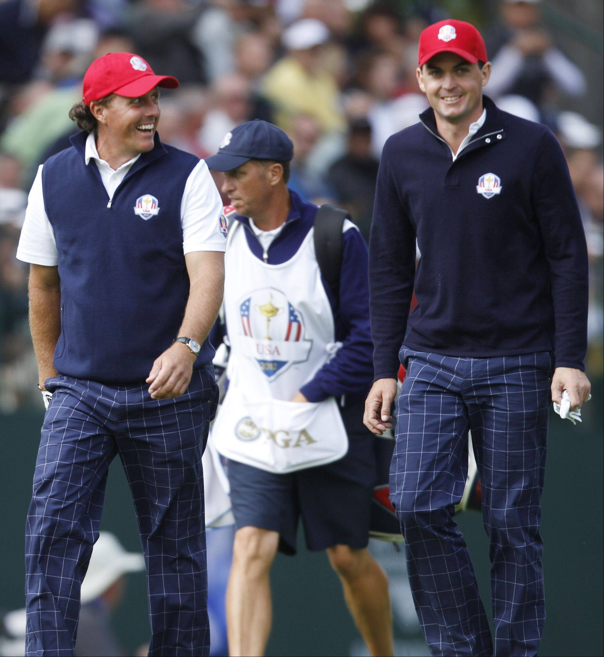 Teammate Phil Mickelson, left, says no one handles pressure better than Keegan Bradley. The two teamed up to win two matches and give the United States a lead after Friday's Ryder Cup matches at Medinah.