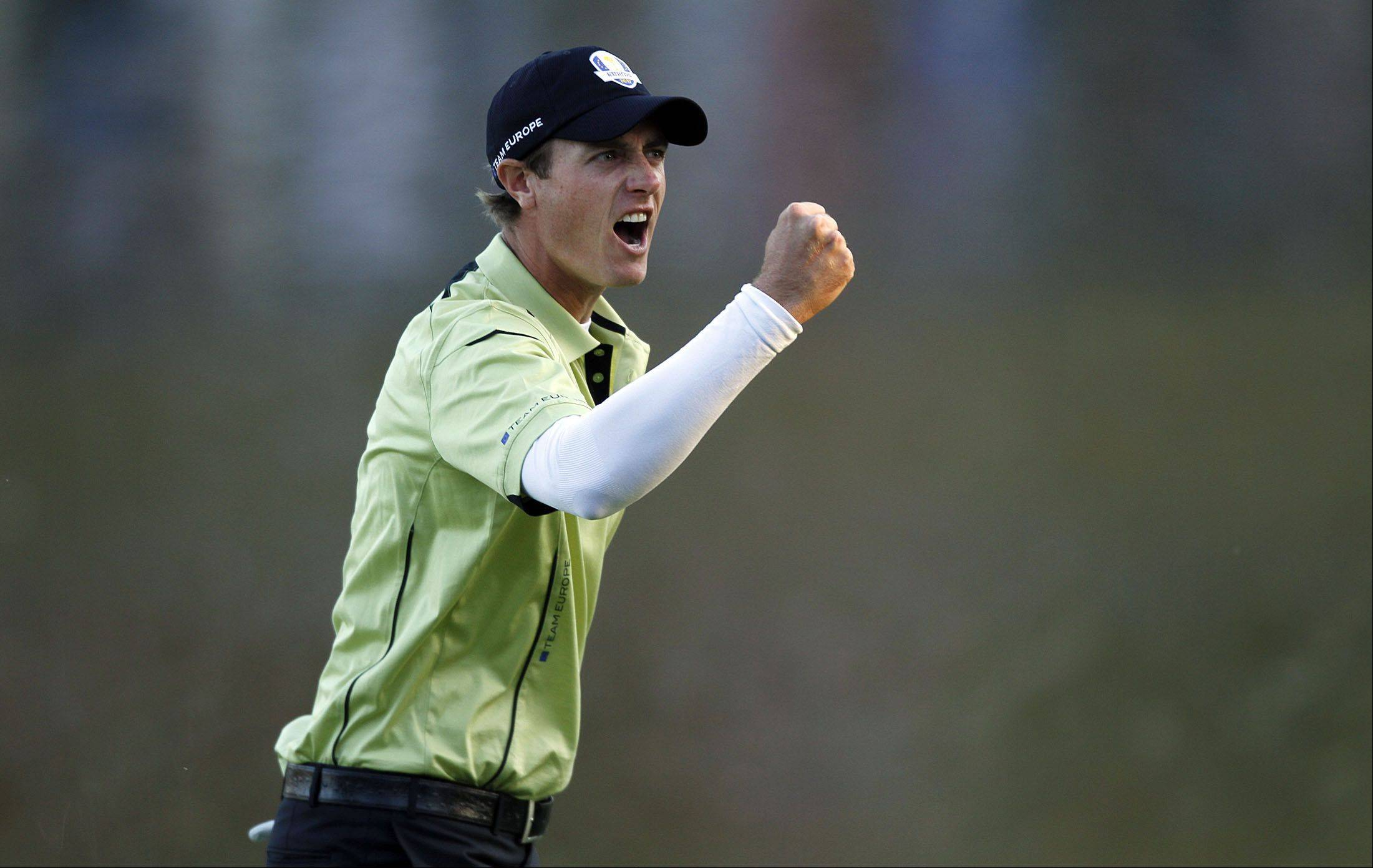 Nicolas Colsaerts, a captains pick for Team Europe, pumps his fist after sinking a birdie putt on 17 during fourball matches Friday at Medinah Country Club.