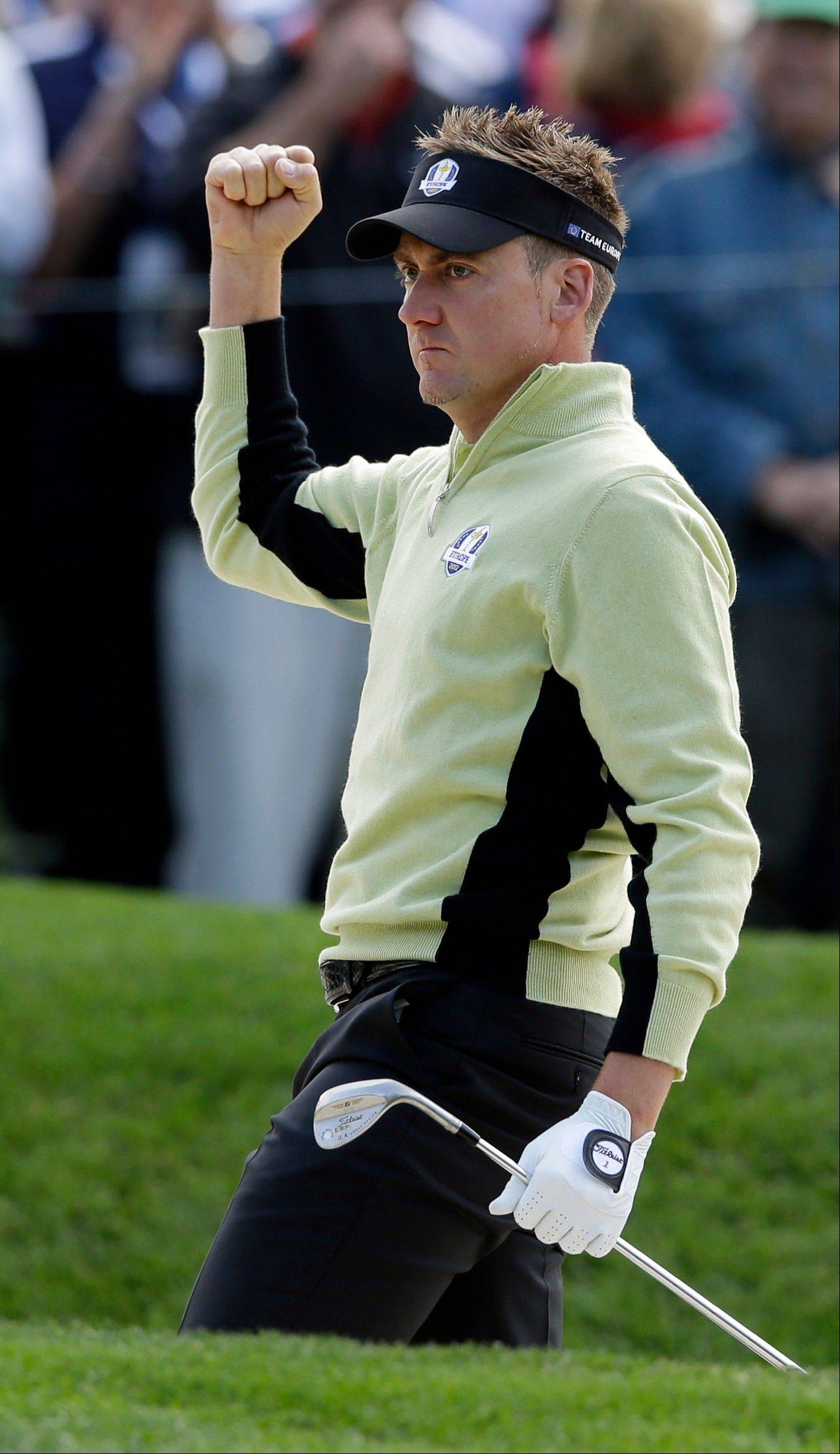 Europe's Ian Poulter reacts after chipping in for a birdie on the 11th hole during a foursomes match at the Ryder Cup PGA golf tournament Friday at Medinah Country Club.