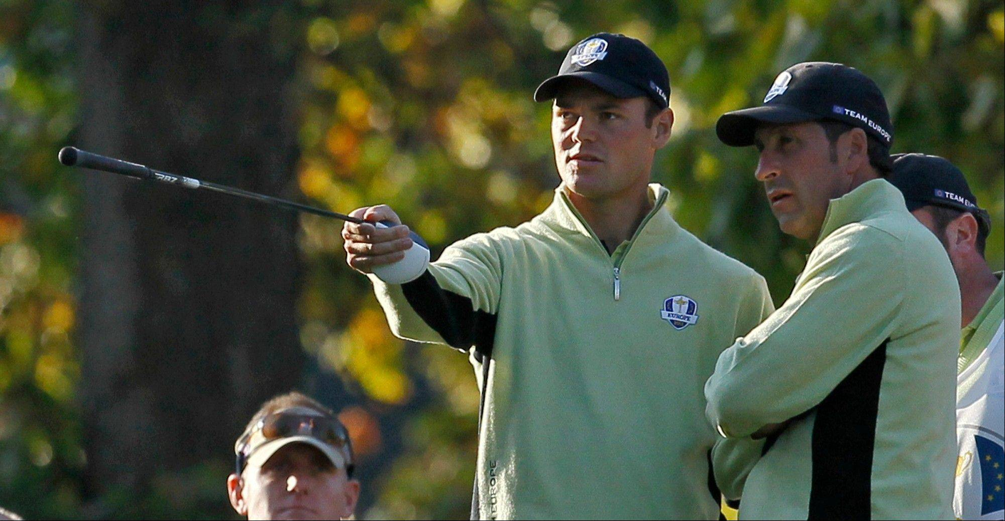 European team captain Jose Maria Olazabal, right, talks to Martin Kaymer during a fourball match at the Ryder Cup Friday at Medinah Country Club. Europe trails 5-3 going into Saturday's matches.