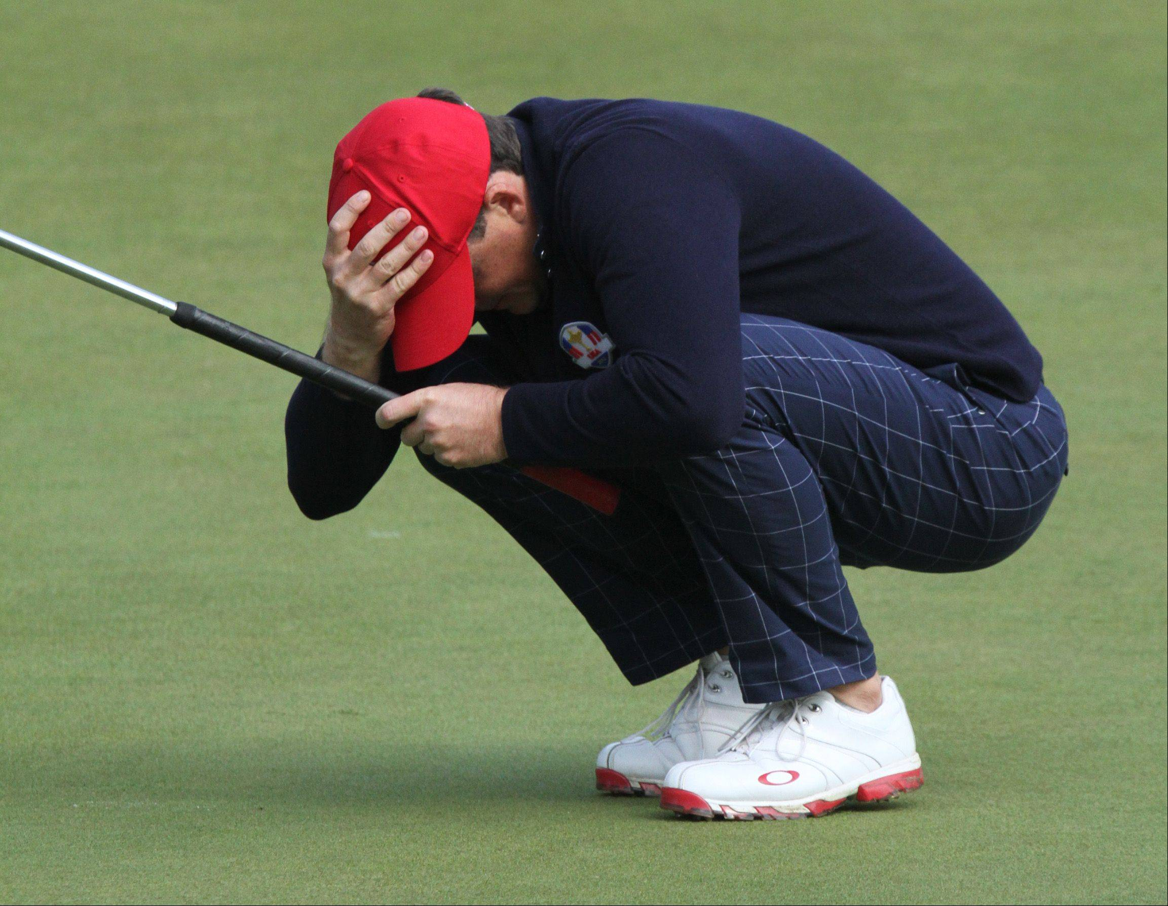 USA rookie Keegan Bradley reacts to missing a putt on the 14th hole, but he didn't miss much else on the day as he earned 2 points with partner Phil Mickelson in Friday's Ryder Cup at Medinah Country Club.