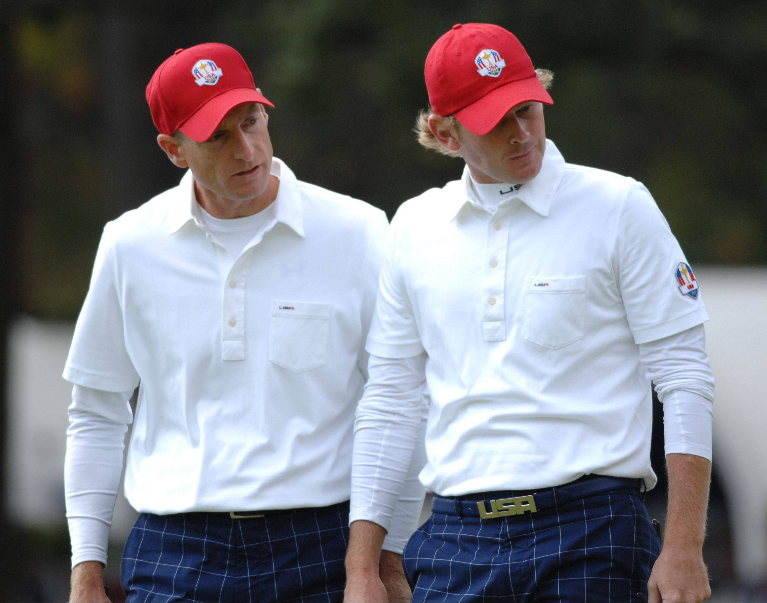 Team USA teammates Jim Furyk, left, and rookie Brandt Snedeker staged a late rally in their foursome match Friday morning at Medinah before falling on the 18th hole.