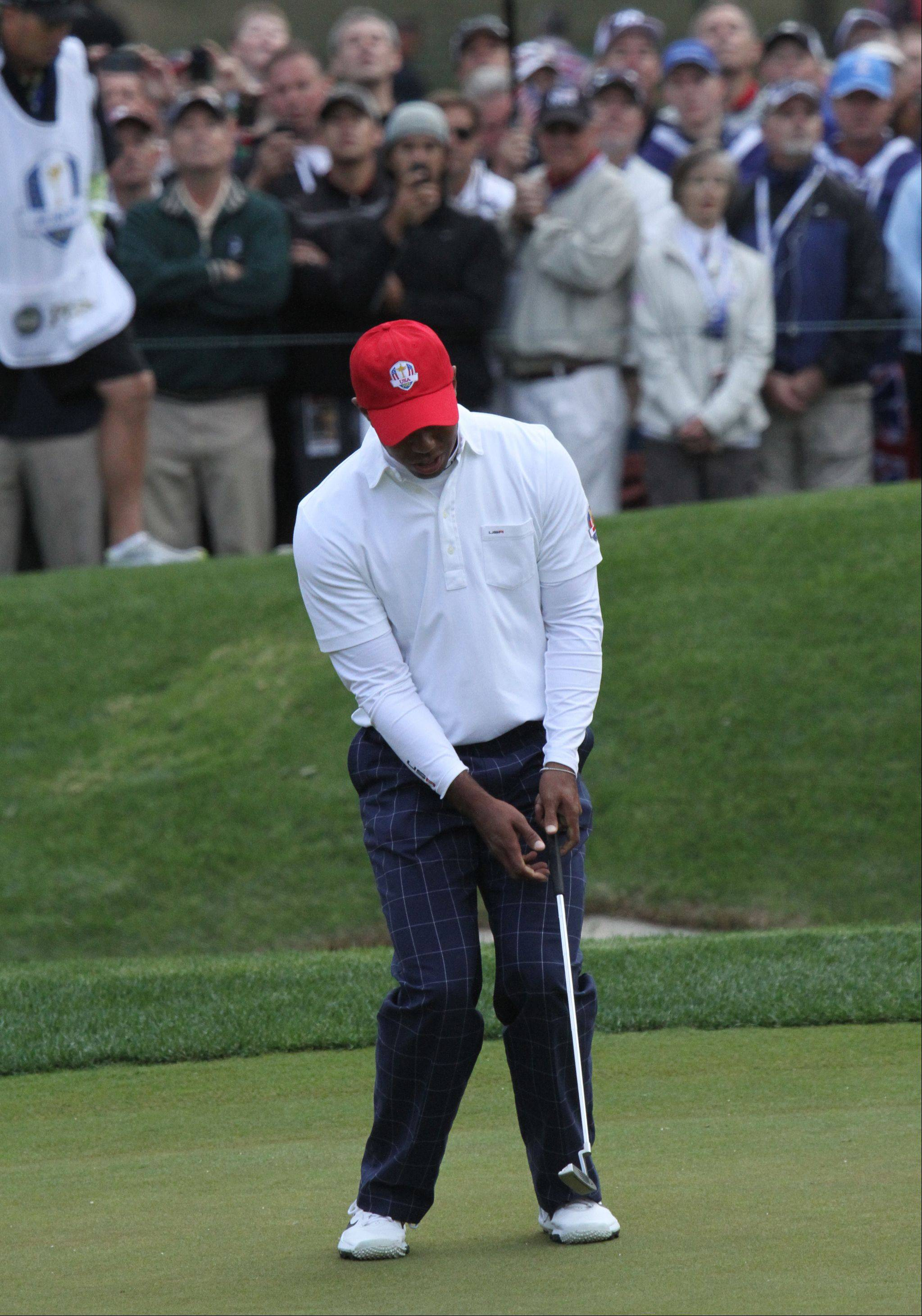 Tiger Woods reacts after missing a putt on the 3rd hole during the Friday's morning round at the Ryder Cup at Medinah Country Club.
