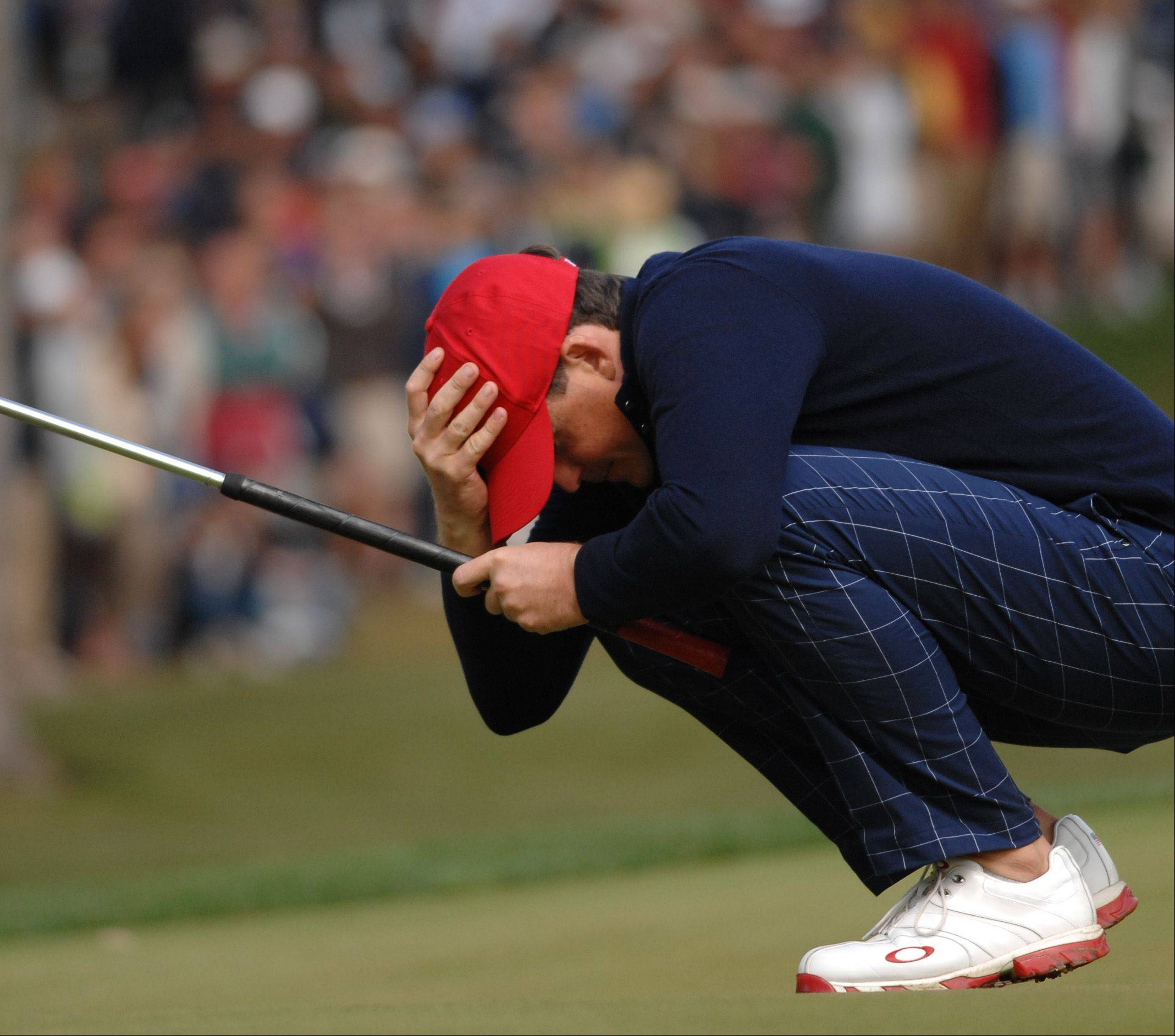 Keegan Bradley reacts to a missed putt on 14 Friday morning during foursome matches at Medinah.