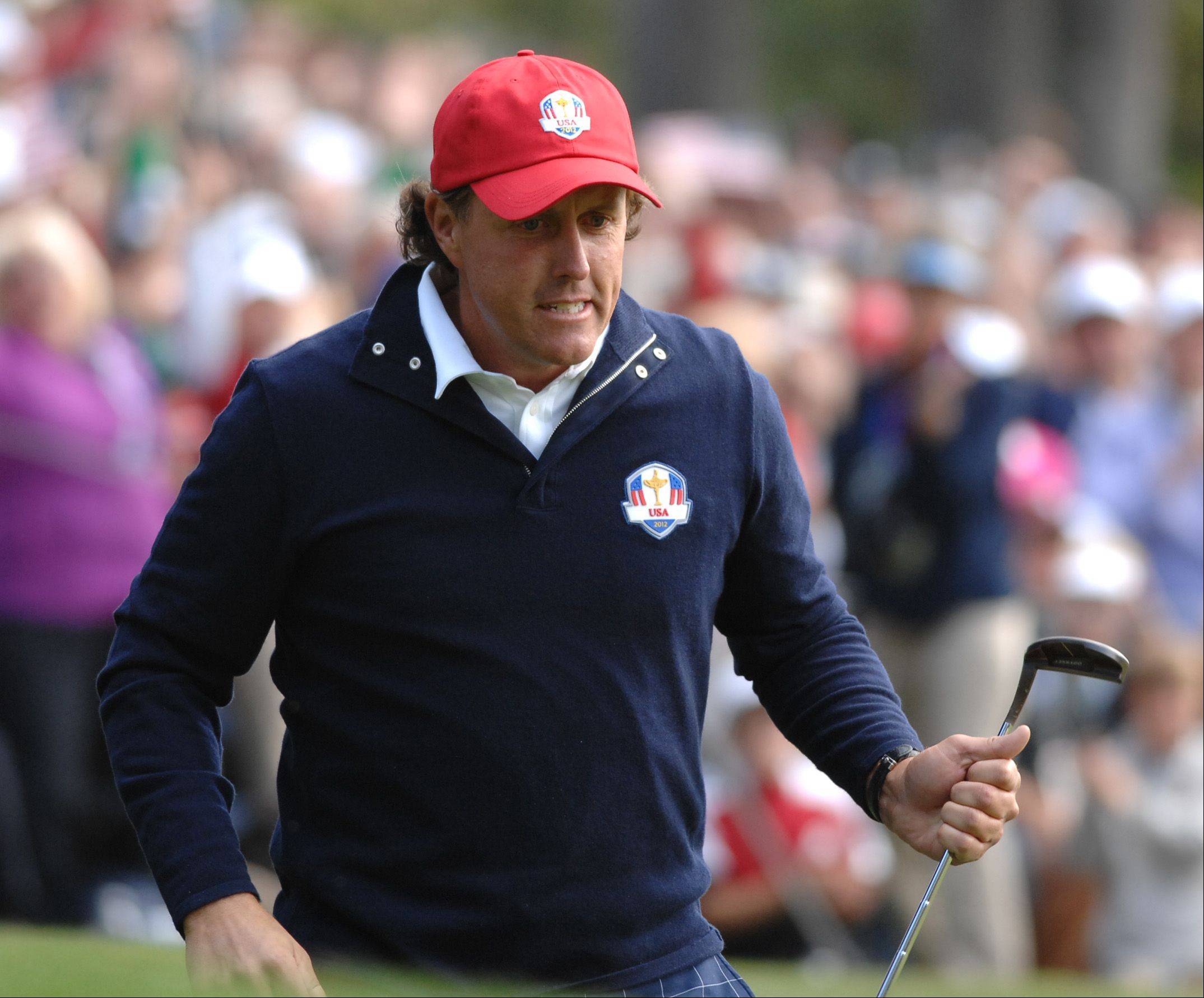Phil Mickelson grits his teeth after getting pumped up with teammate Keegan Bradley during the foursome match Friday morning. Mickelson hit a birdie putt on 13.