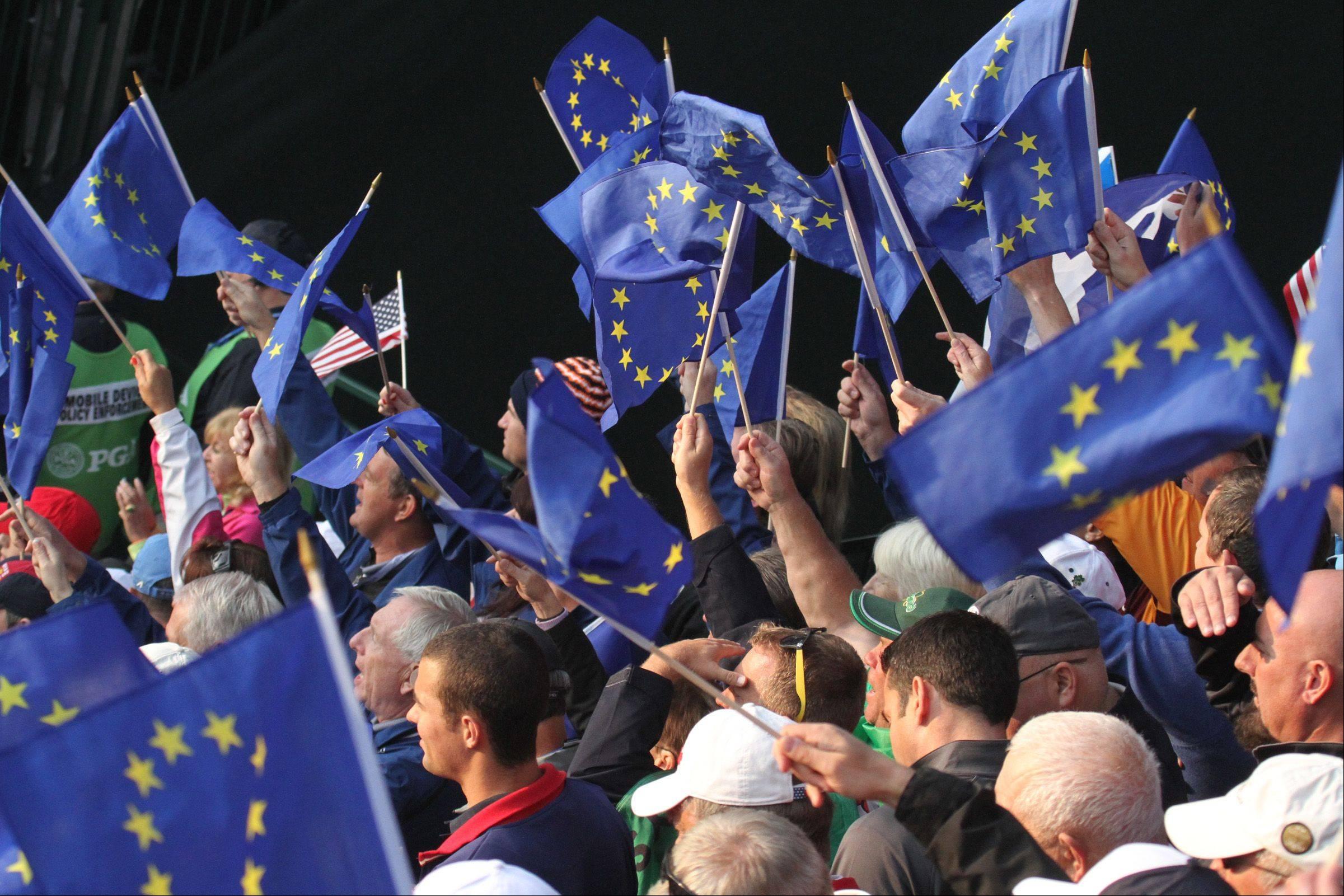 Team Europe fans get charged up in the stand on the first tee Friday morning.