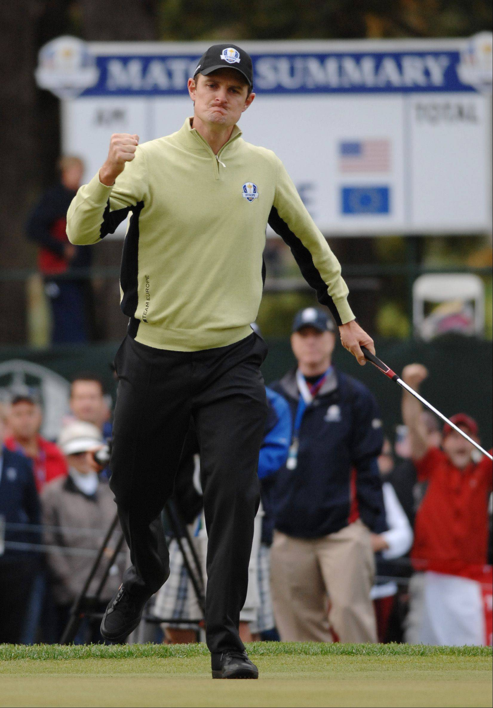 Justin Rose of Team Europe reacts to sinking a putt on 4 Friday morning during the foursome matches.