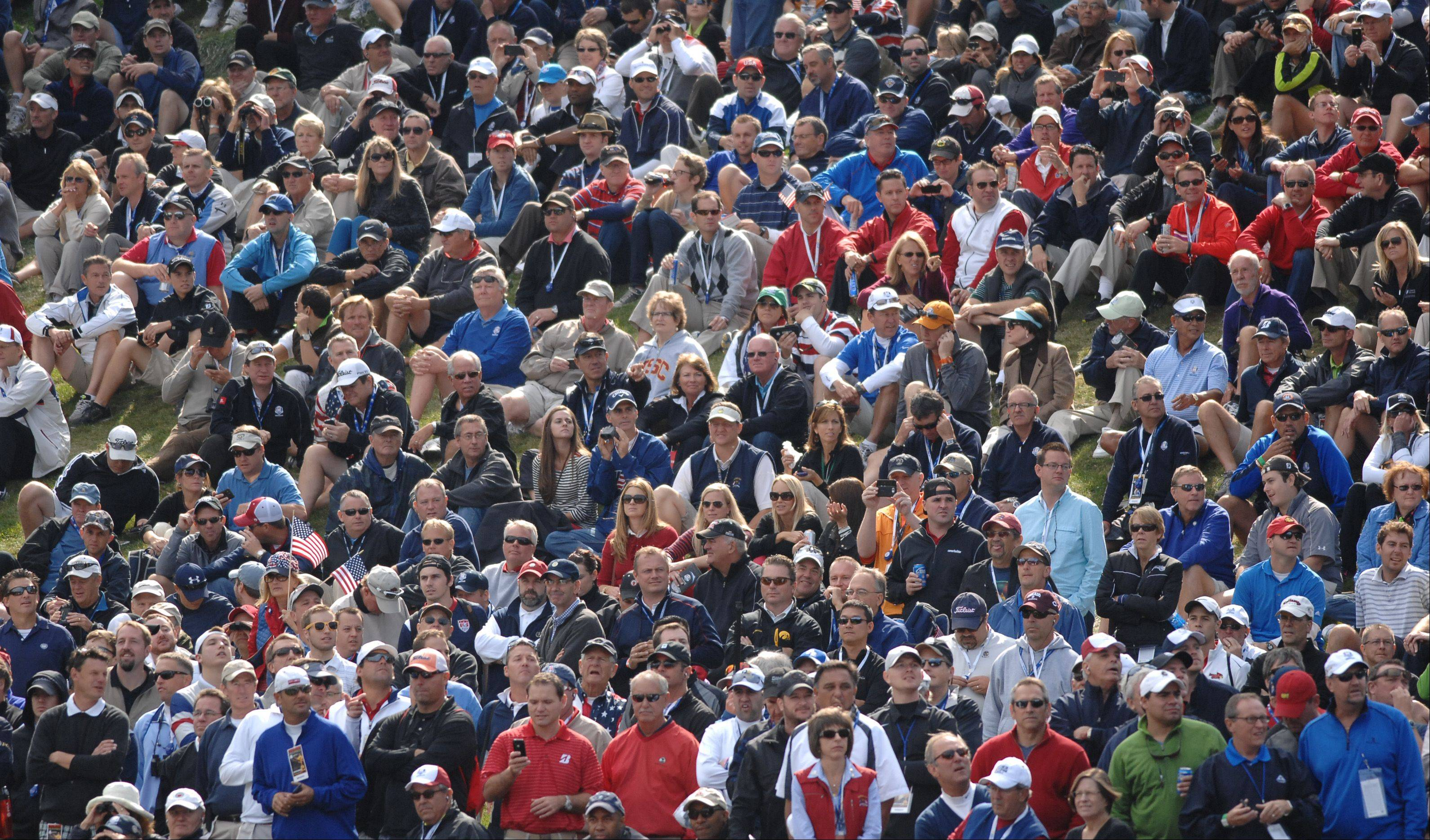 Thousands of fans lined the fairways and bleachers of Medinah Country Club Friday for the first day of the Ryder Cup.