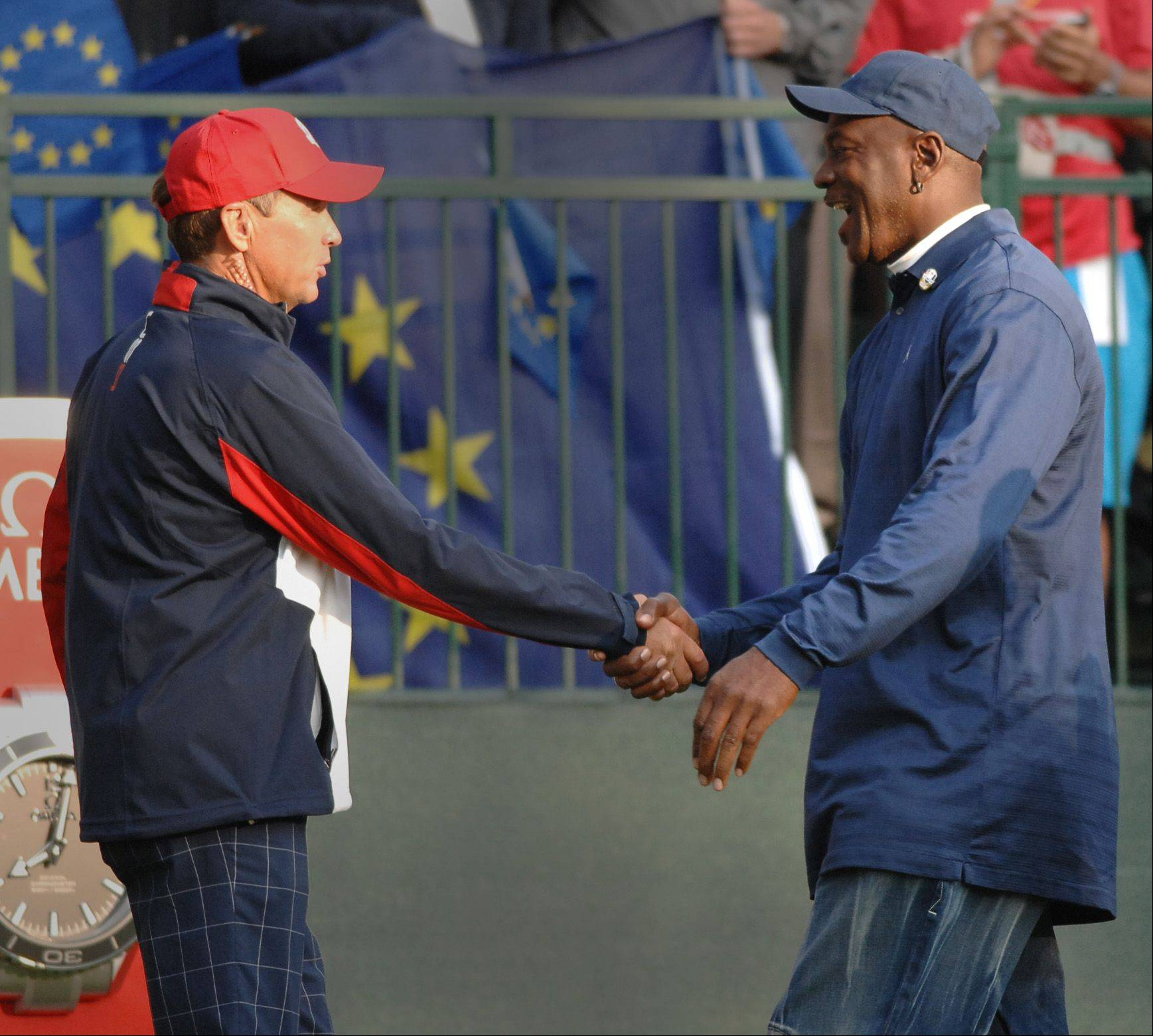 Team USA captain Davis Love III greets basketball legend Michael Jordan on the first tee Friday morning.