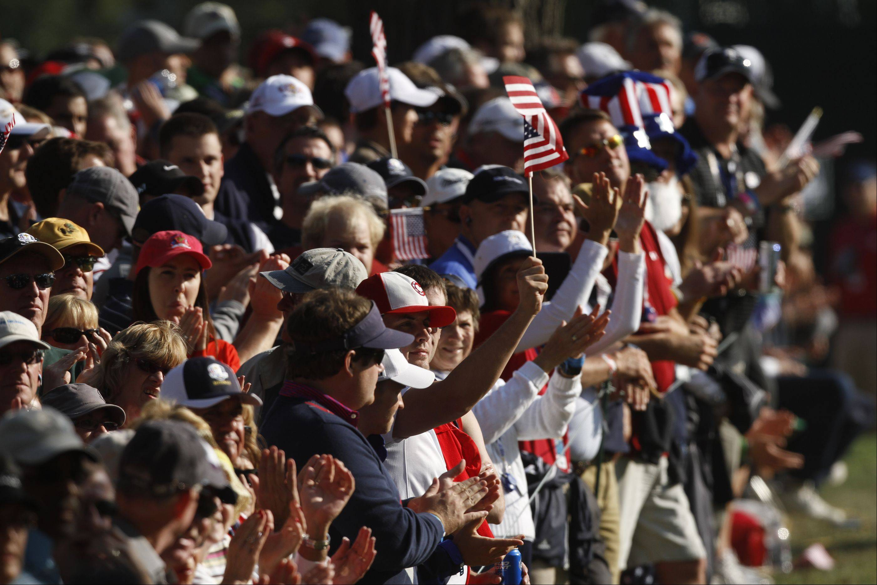 Fans cheer on Team USA on the 16th hole during the afternoon round play of the 2012 Ryder Cup at Medinah Country Club.