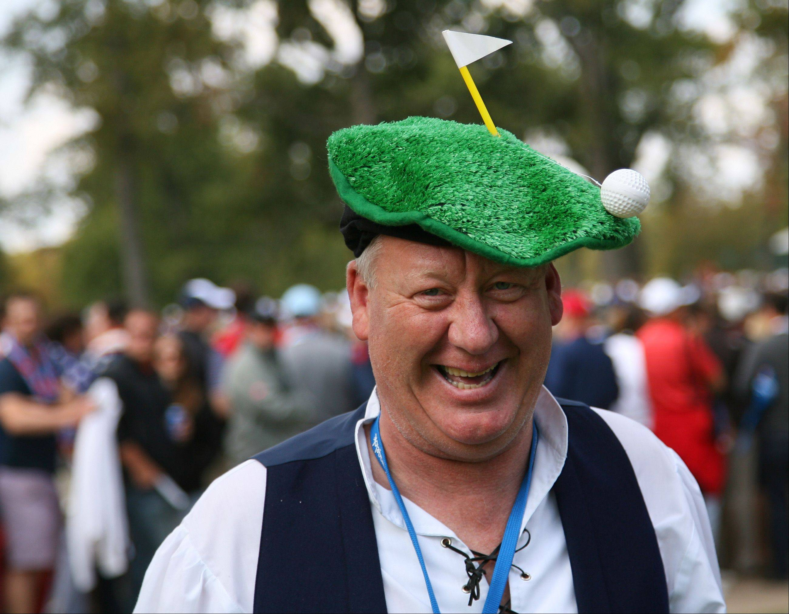 A Team Europe fan is all smiles with a rather ingenious hat at Medinah Country Club.