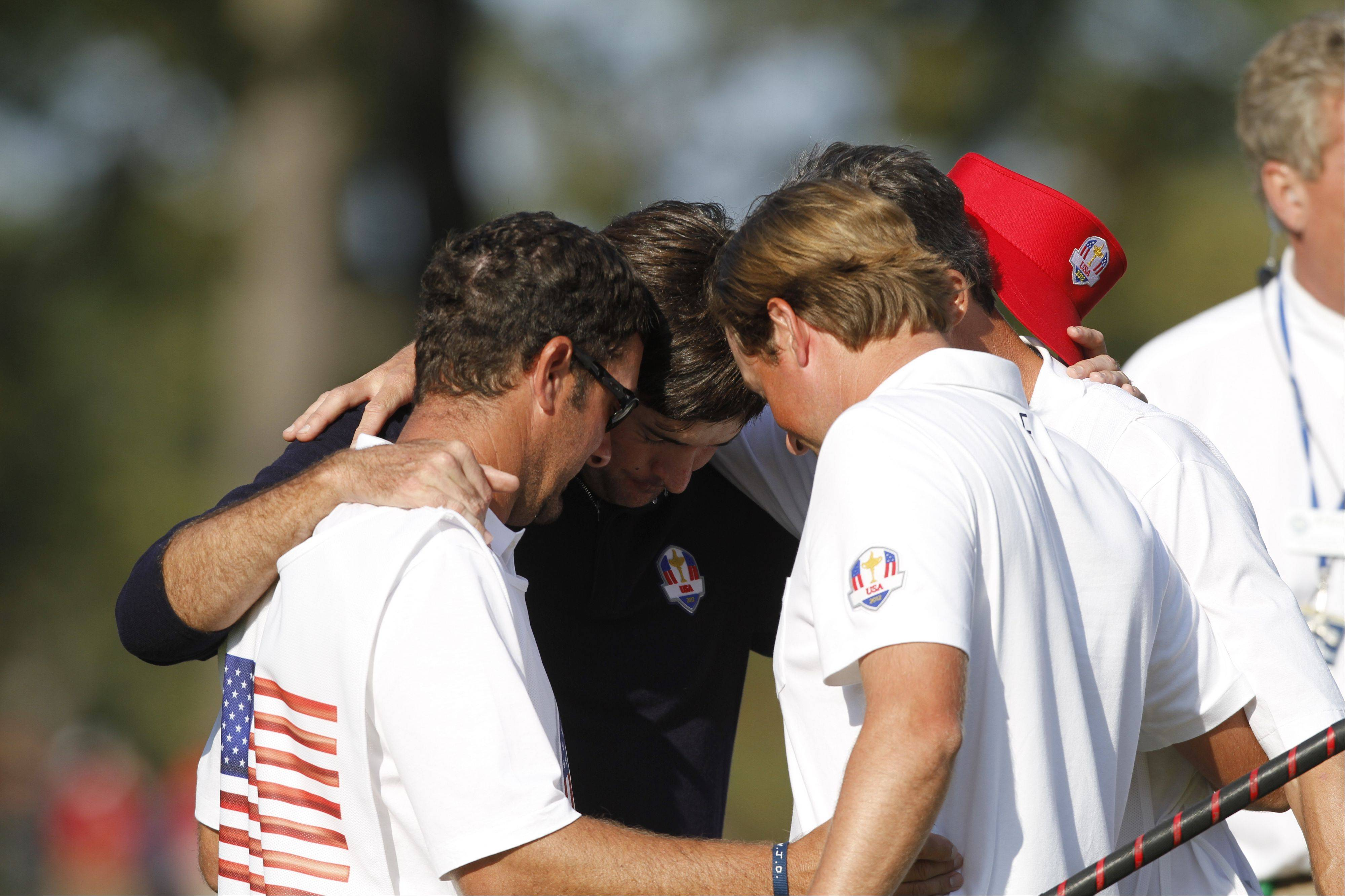 Bubba Waston prays after winning his afternoon match Friday at the 2012 Ryder Cup at Medinah Country Club.