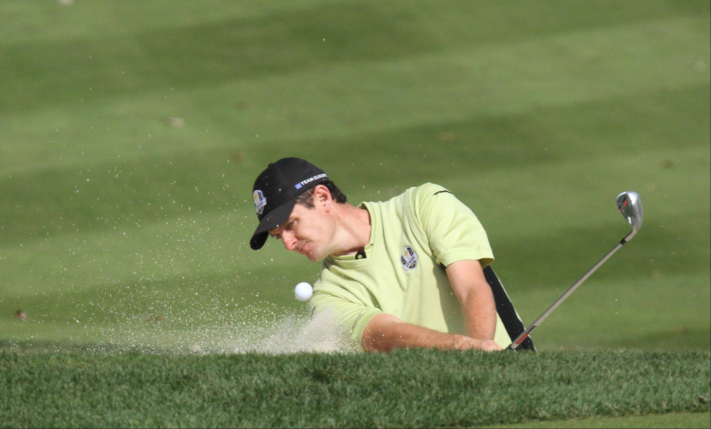 Luke Donald chipping out of the bunker on the 14th hole during opening round play of the 2012 Ryder Cup at Medinah Country Club.