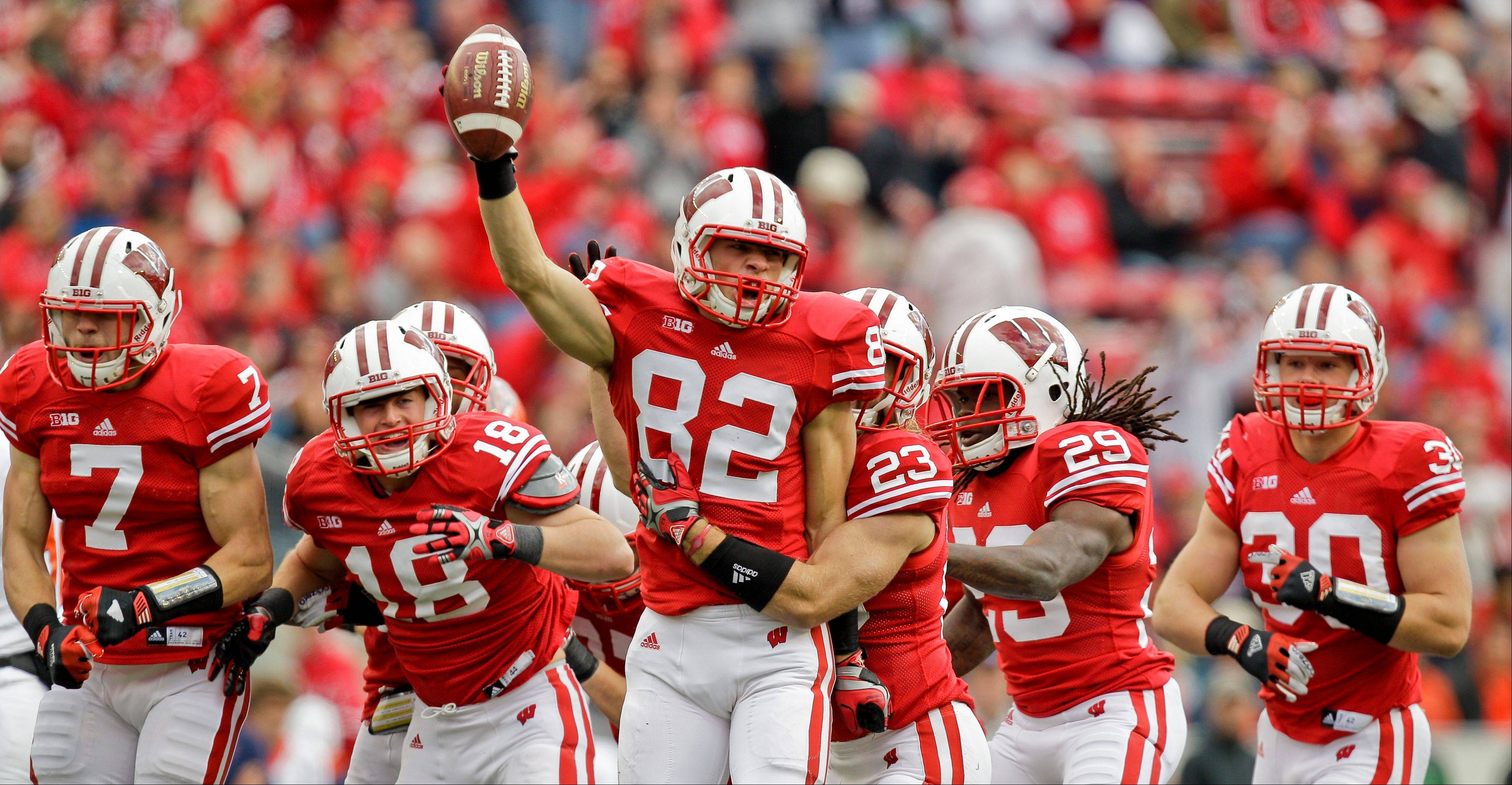 Wisconsin's Jake Stengel (82) celebrates after recovering a fumble on a kickoff against UTEP last Saturday in Madison, Wis.