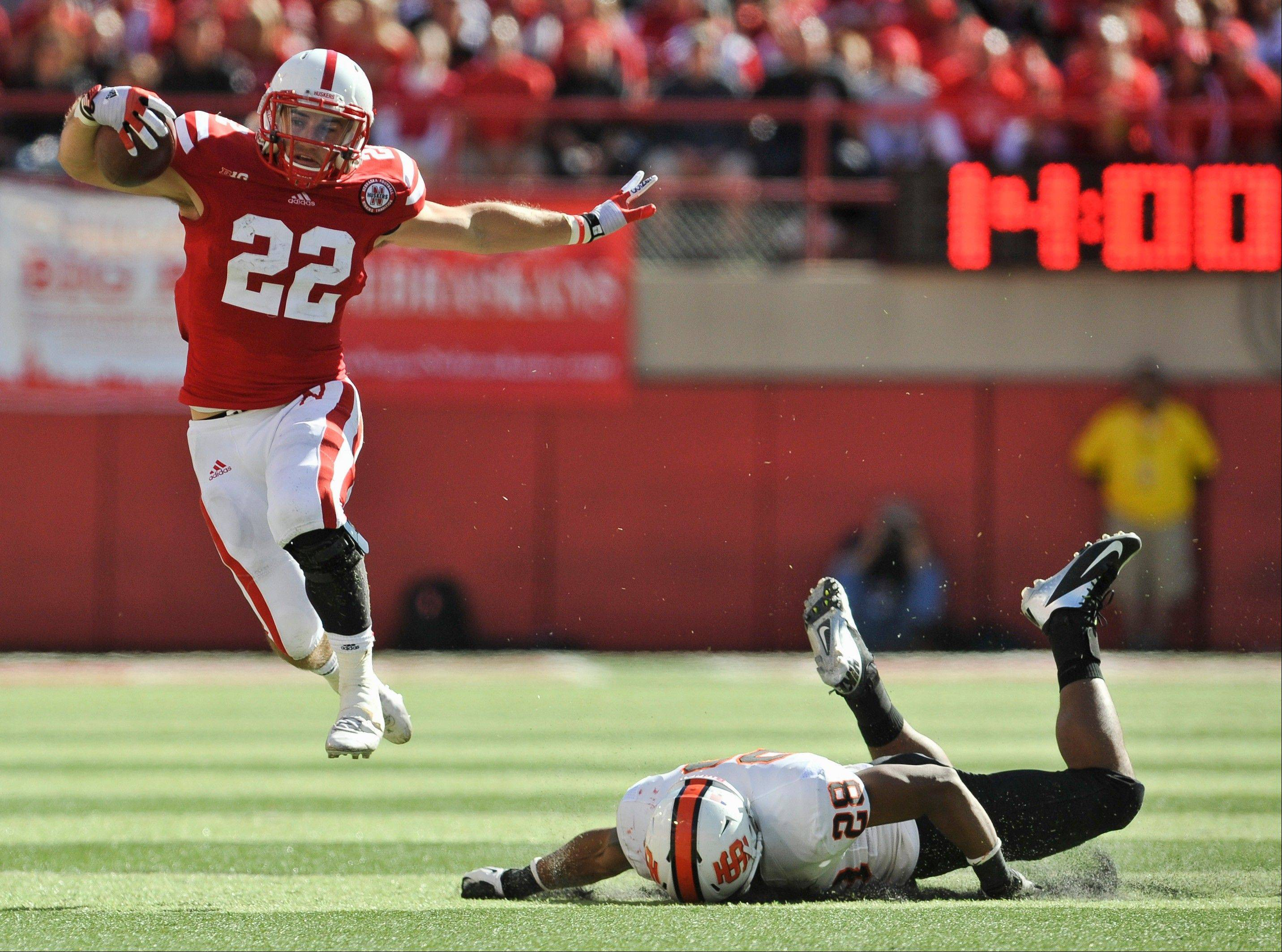 Nebraska's Rex Burkhead eluds a tackle by Idaho State's Cameron Gupton last Saturday in Lincoln, Neb.