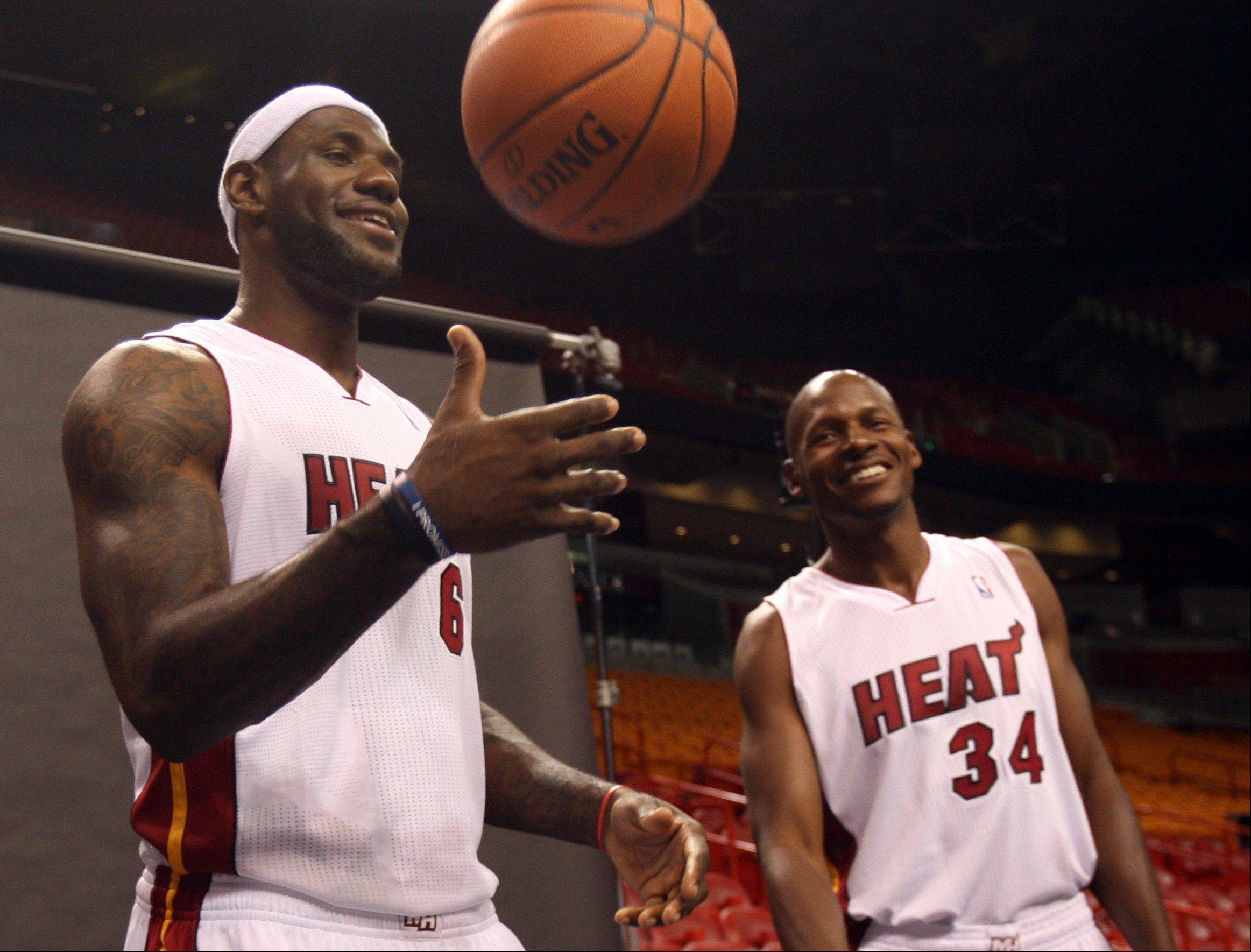 Miami Heat players LeBron James, left, and Ray Allen wait for their turn to have their pictures taken Friday during the team's NBA media day in Miami.