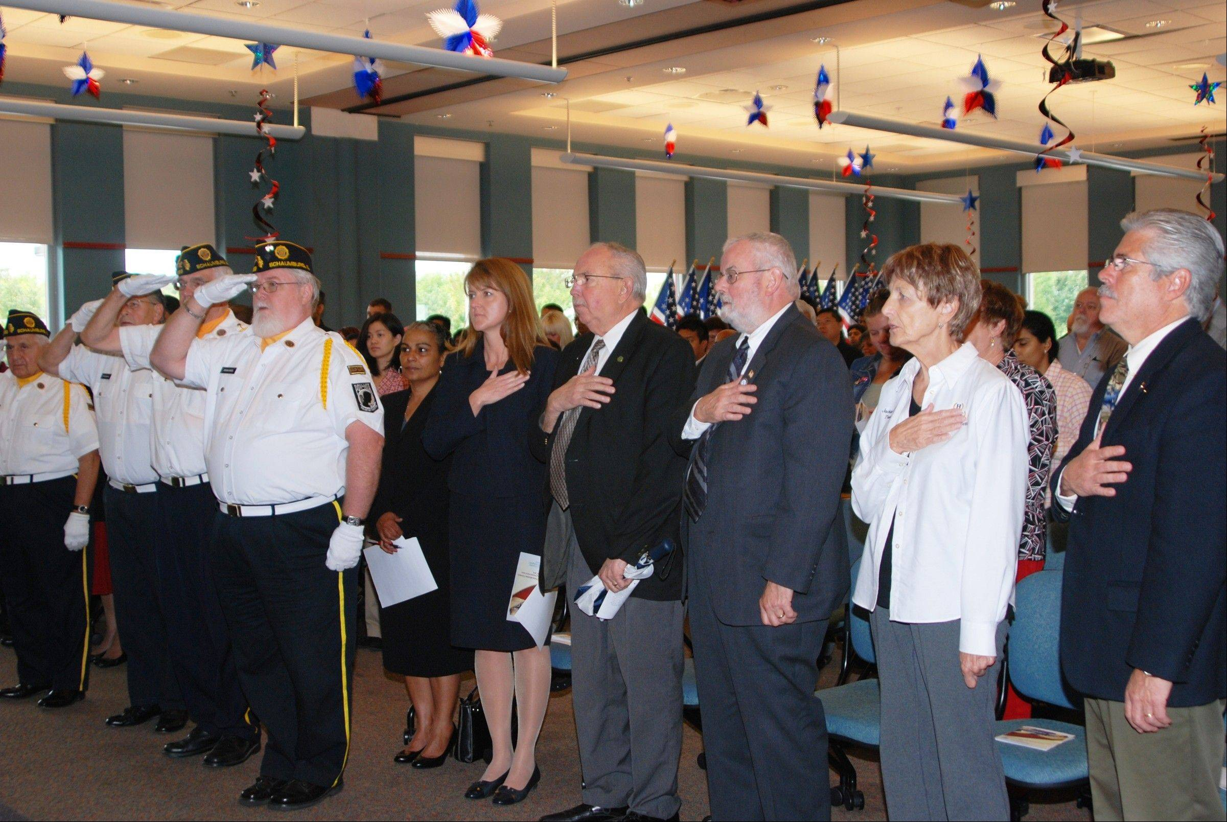 New U.S. citizens and special guests stand for the Pledge of Allegiance during the Sept. 21 ceremony.