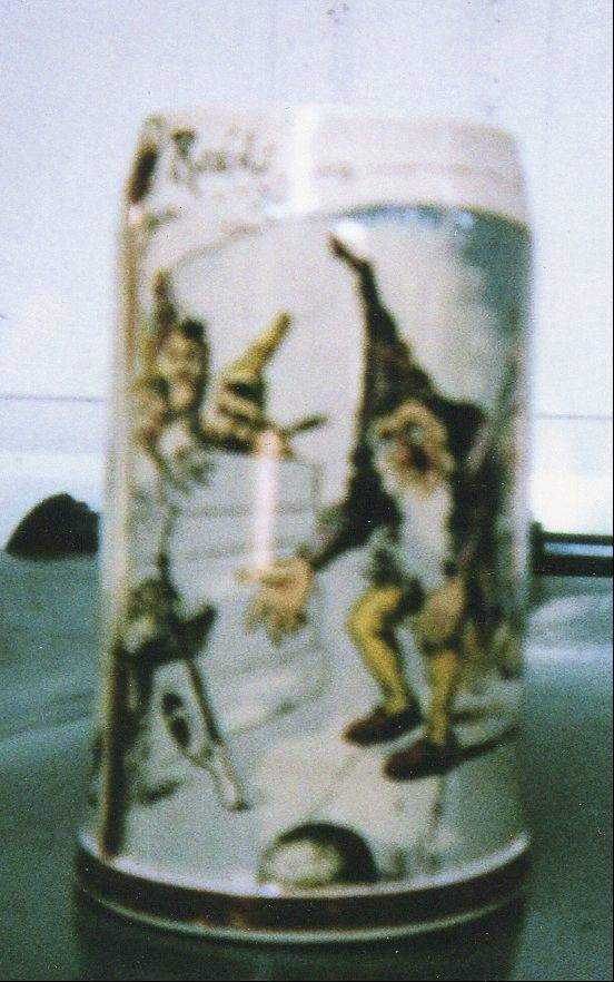 This whimsical stein showing gnomes bowling was made in Germany.