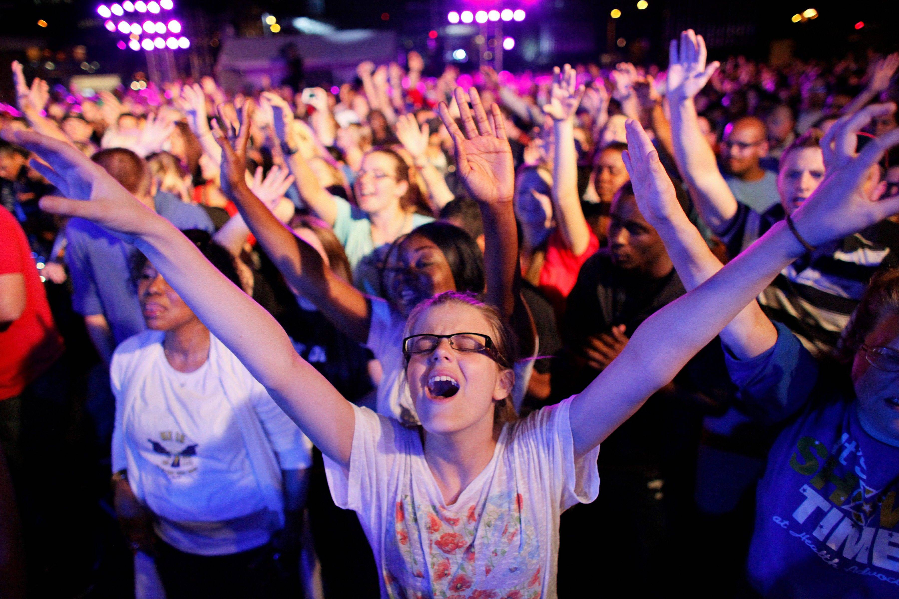 Associated Press Dharma Bohall, 13, extends her arms in prayer during the America for Jesus prayer rally in Philadelphia.