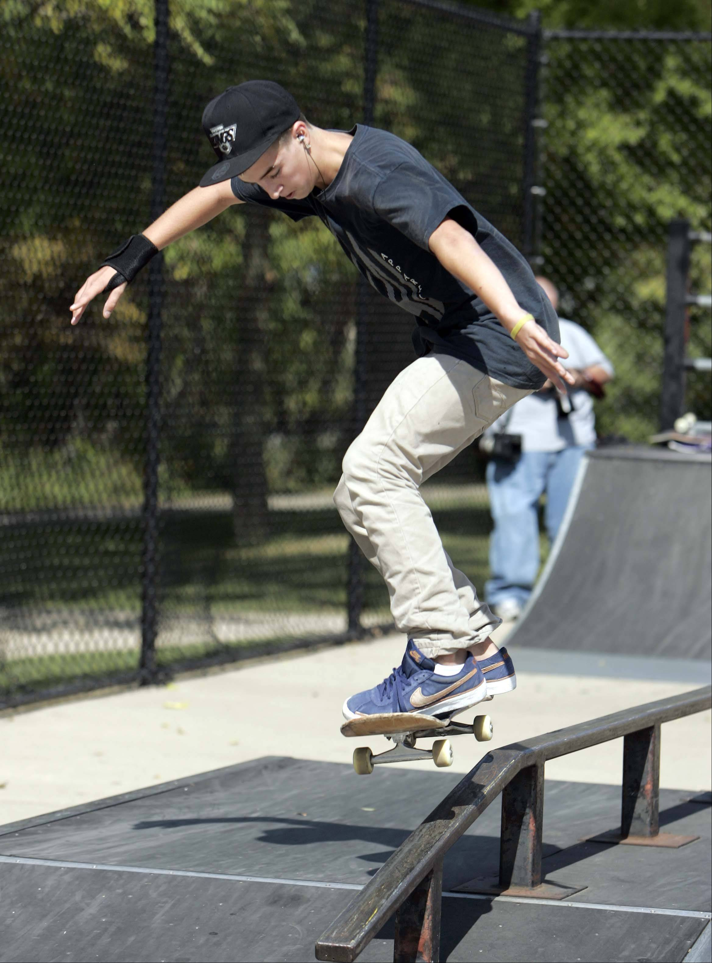 Danny Beauchamp, 15, of North Aurora ollies up to a 5-50 grind during the Batavia Teen Center�s third-annual skateboard competition Saturday at Blackard Skate-n-Bike Park in Batavia.