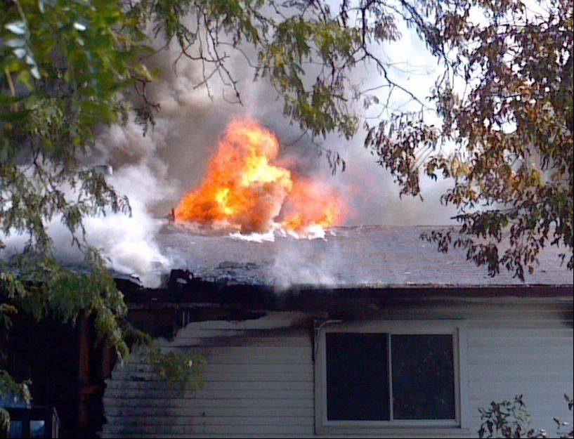 Firefighters work Saturday morning to extinguish a fire at a single-family home on Trailside Court in Hoffman Estates.