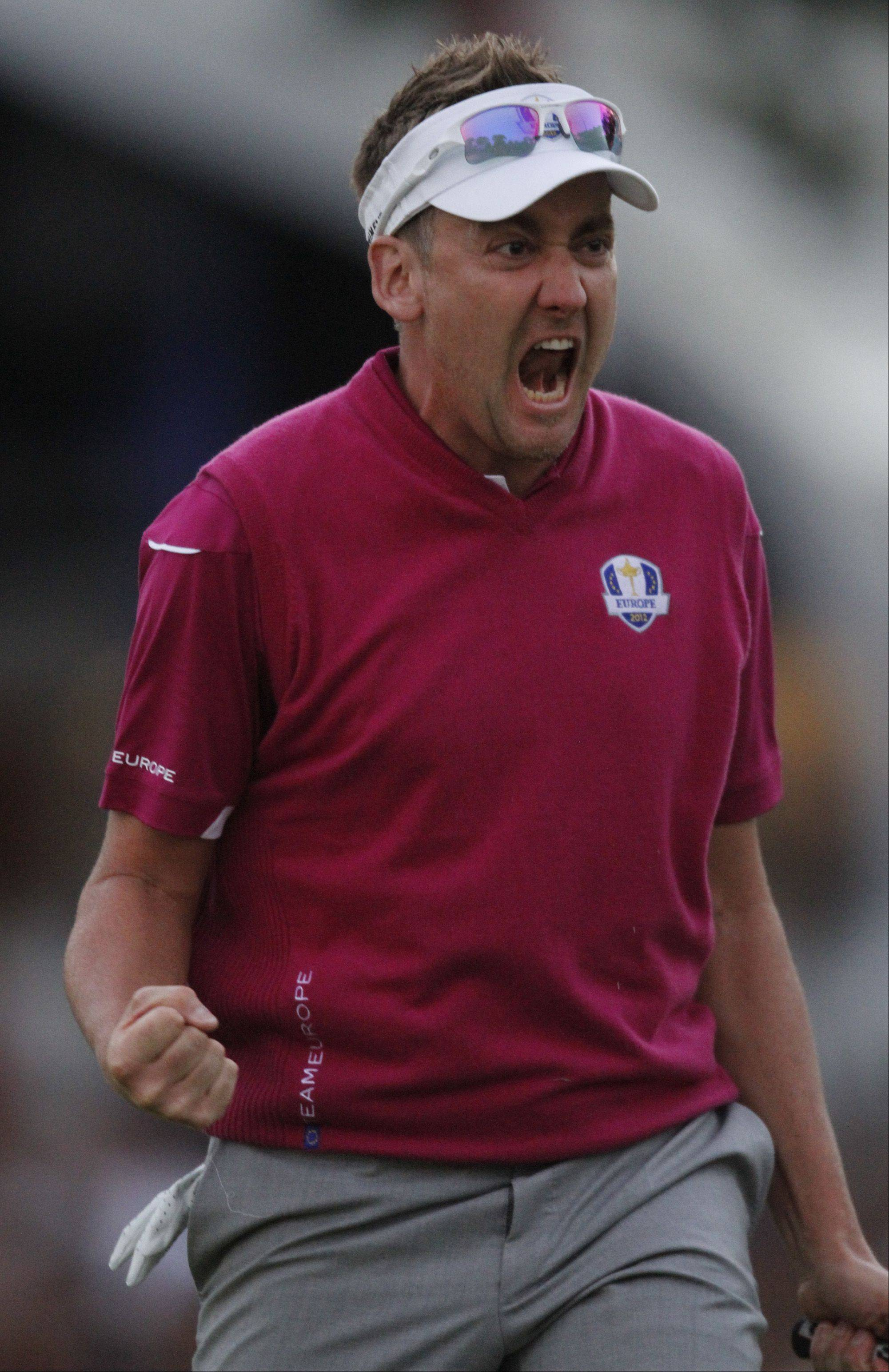 Team Europe's Ian Poulter is pumped after sinking a putt to finish 1 up on Team USA at the 18th Saturday in the 39th Ryder Cup. Poulter is 3-0-0 for Europe at Medinah.