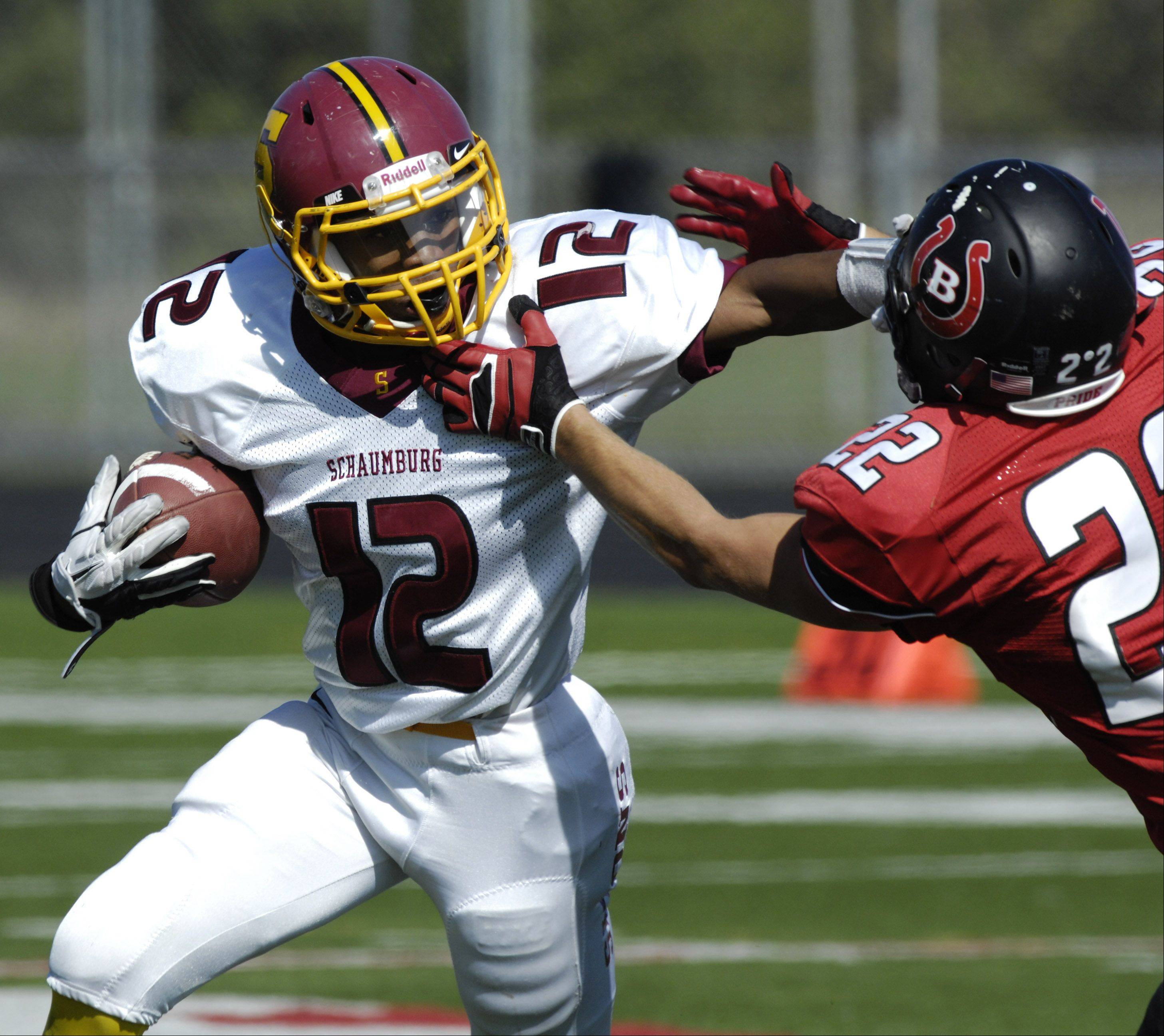 Schaumburg�s Stacey Smith, left, breaks free from Barrington�s Nick Coy during Saturday�s game.