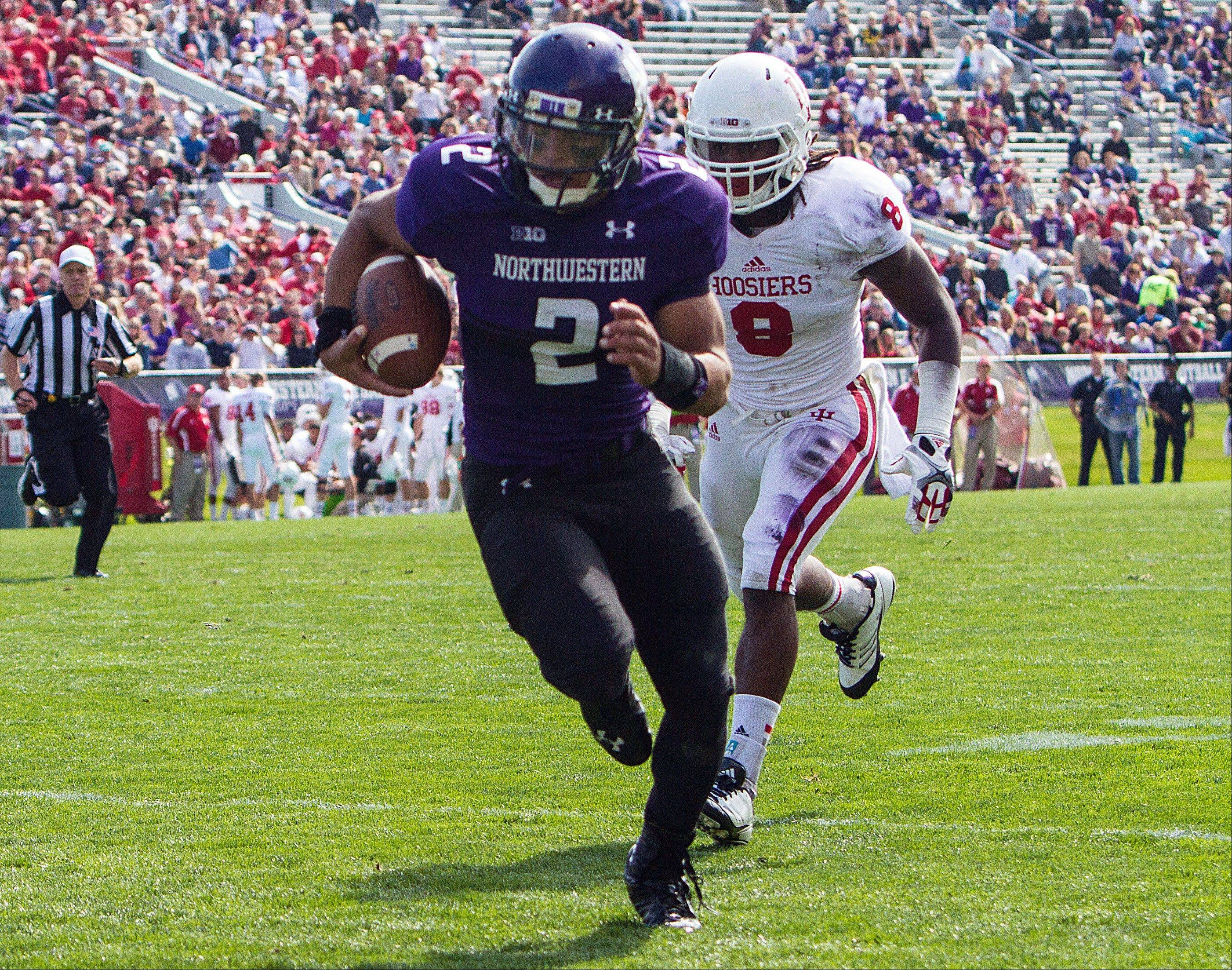 Northwestern's Kain Kolter runs for a touchdown against Indiana Saturday during the second quarter in Evanston.
