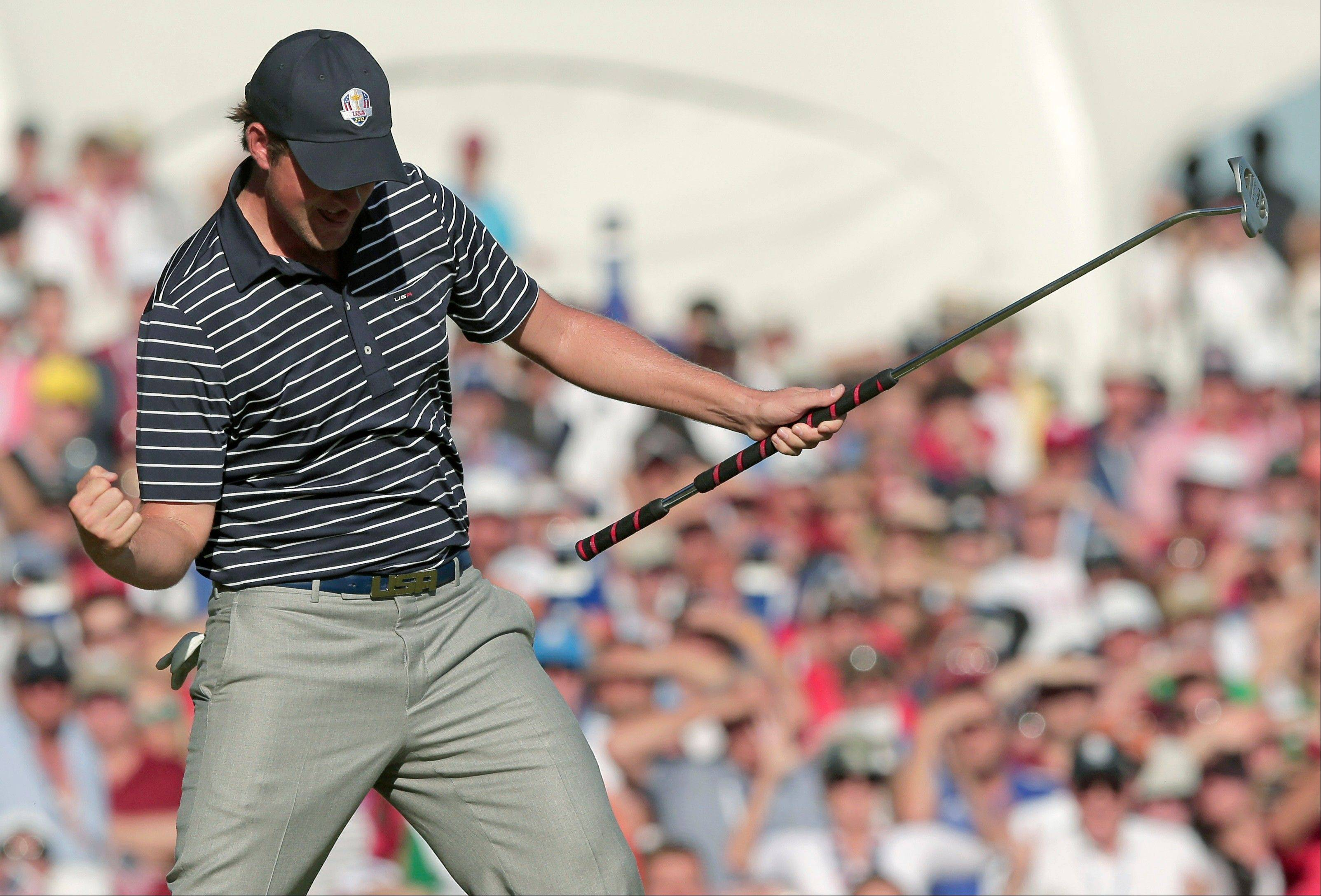USA's Webb Simpson reacts after making a putt to win the 13th hole during a fourball match Saturday at the Ryder Cup. Simpson and Watson won their match to give Team USA a 9-4 lead.