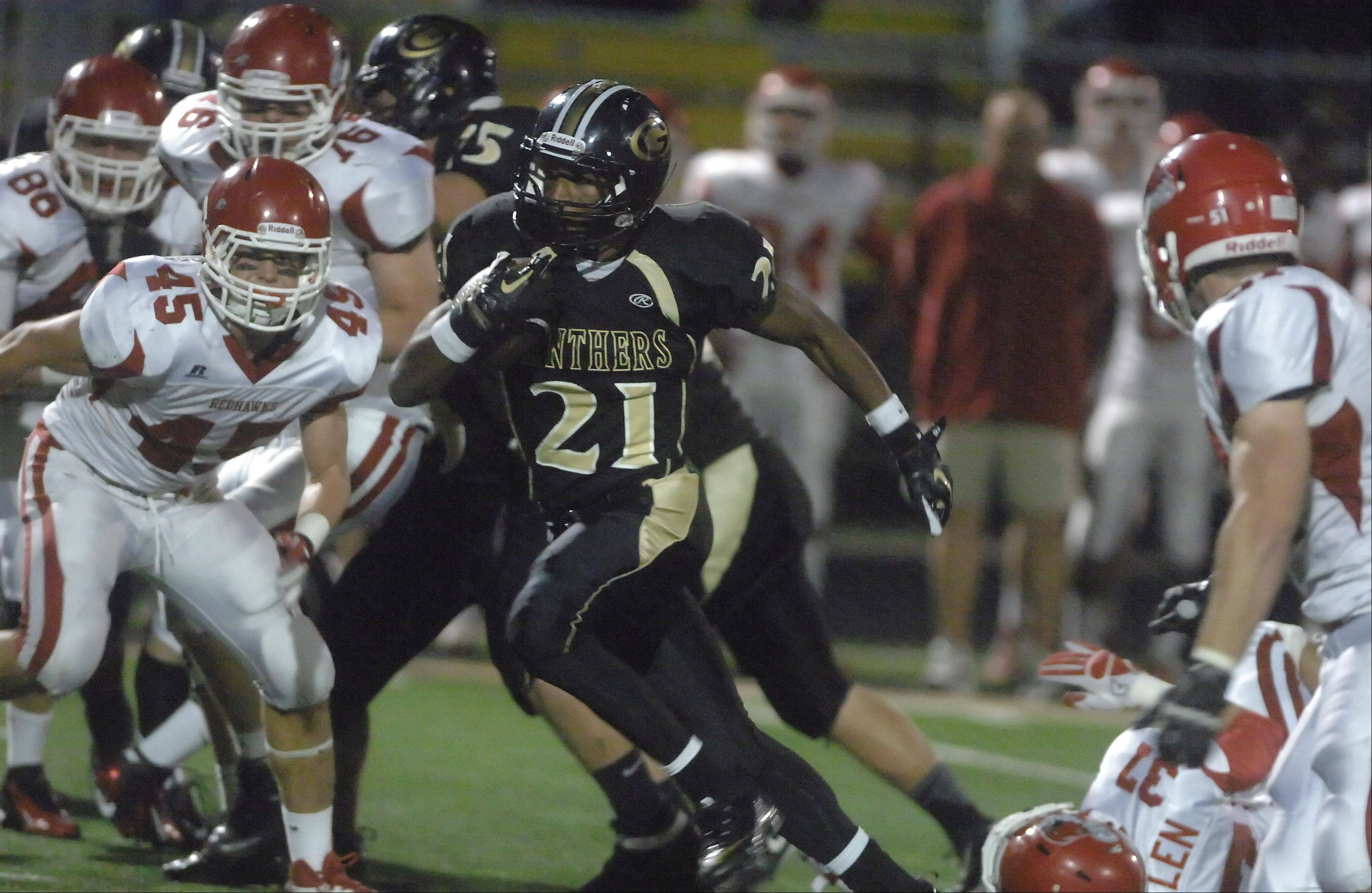 Justin Jackson of Glenbard North moves the ball during the Naperville Central vs. Glenbard North football game Friday in Carol Stream.