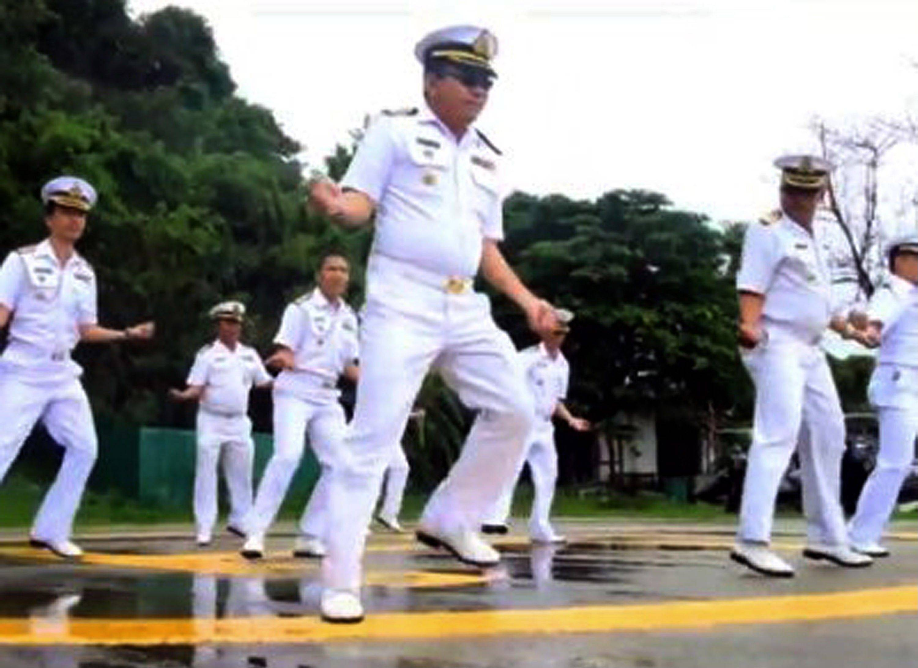 "In this image made from a video released by Thai Royal Navy, Thai sailors perform the rodeo-style dance and other hip-shaking moves of ""Gangnam Style"" at their base on the popular tourist island of Phuket."