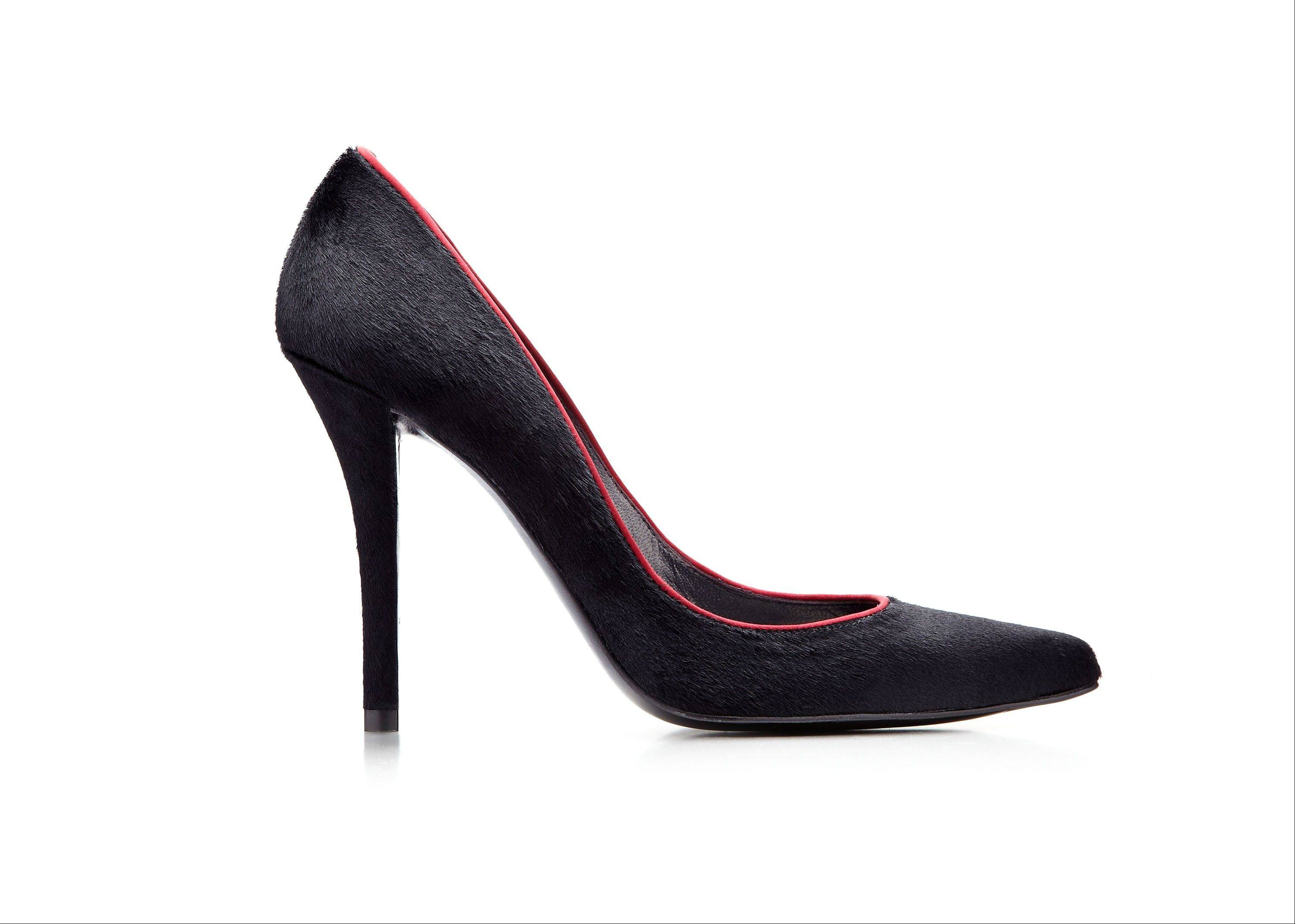 This black pony-hair stiletto pump with burgundy satin piping was codesigned by actress AnnaSophia Robb for a special Stuart Weitzman collection to help raise money for ovarian cancer research.