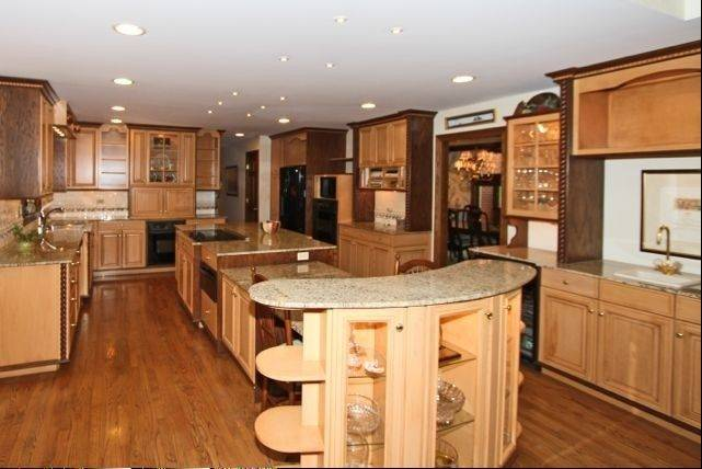 Cherry cabinets are found in the gourmet kitchen.