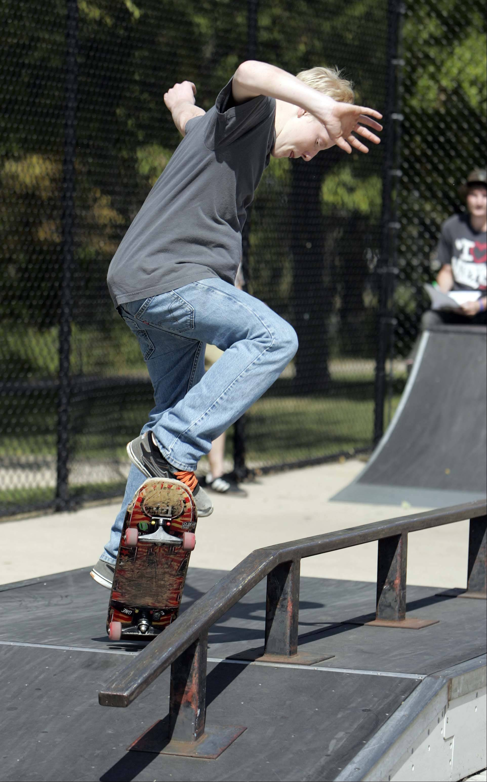 Fifteen-year-old Josh Brehm of Kaneville ollies to a grind during the Batavia Teen Center's third-annual skateboard competition Saturday at Blackard Skate-n-Bike Park in Batavia.