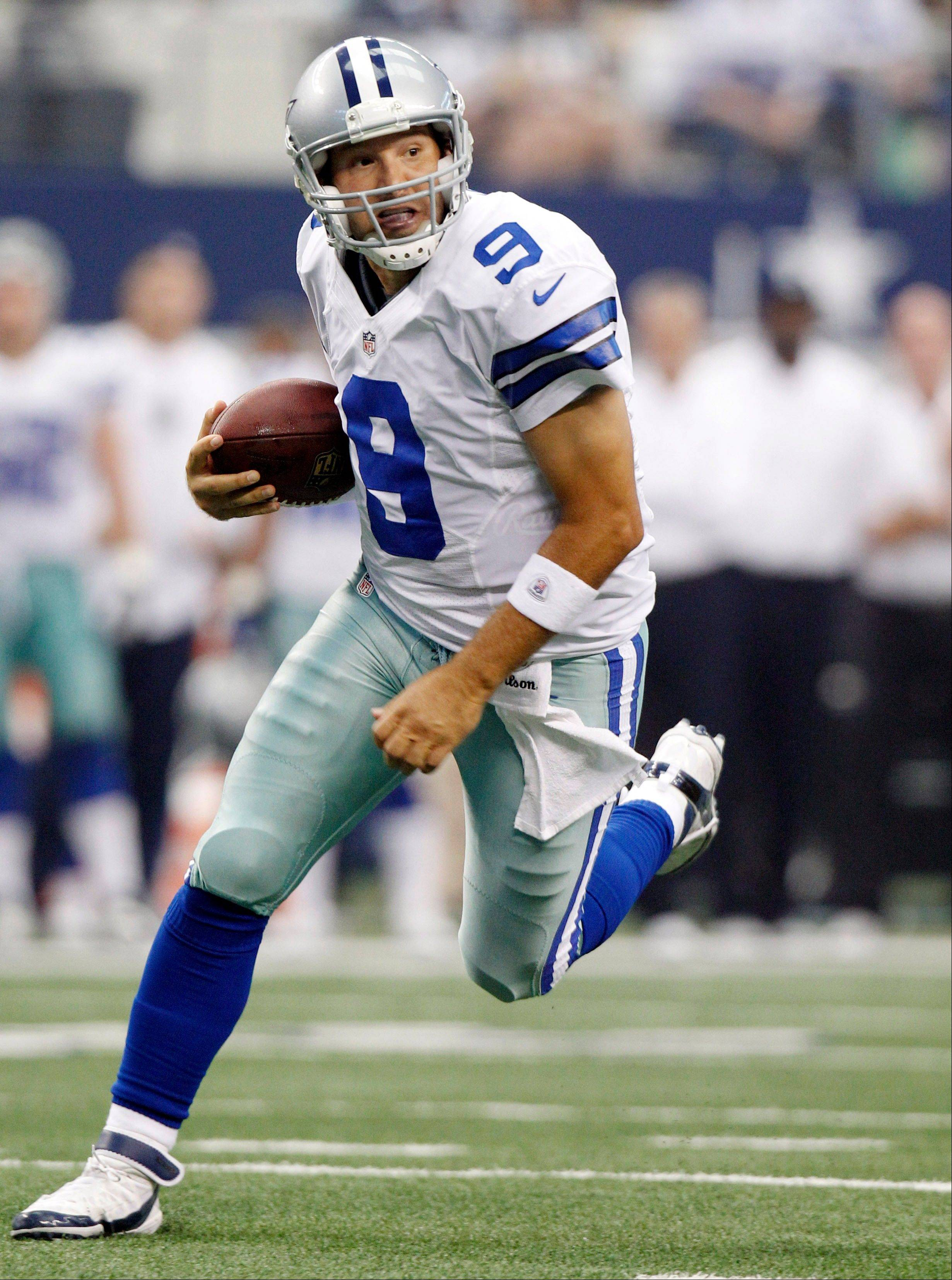 Dallas Cowboys quarterback Tony Romo runs the ball against the Tampa Bay Buccaneers Sunday during the first half in Arlington, Texas.