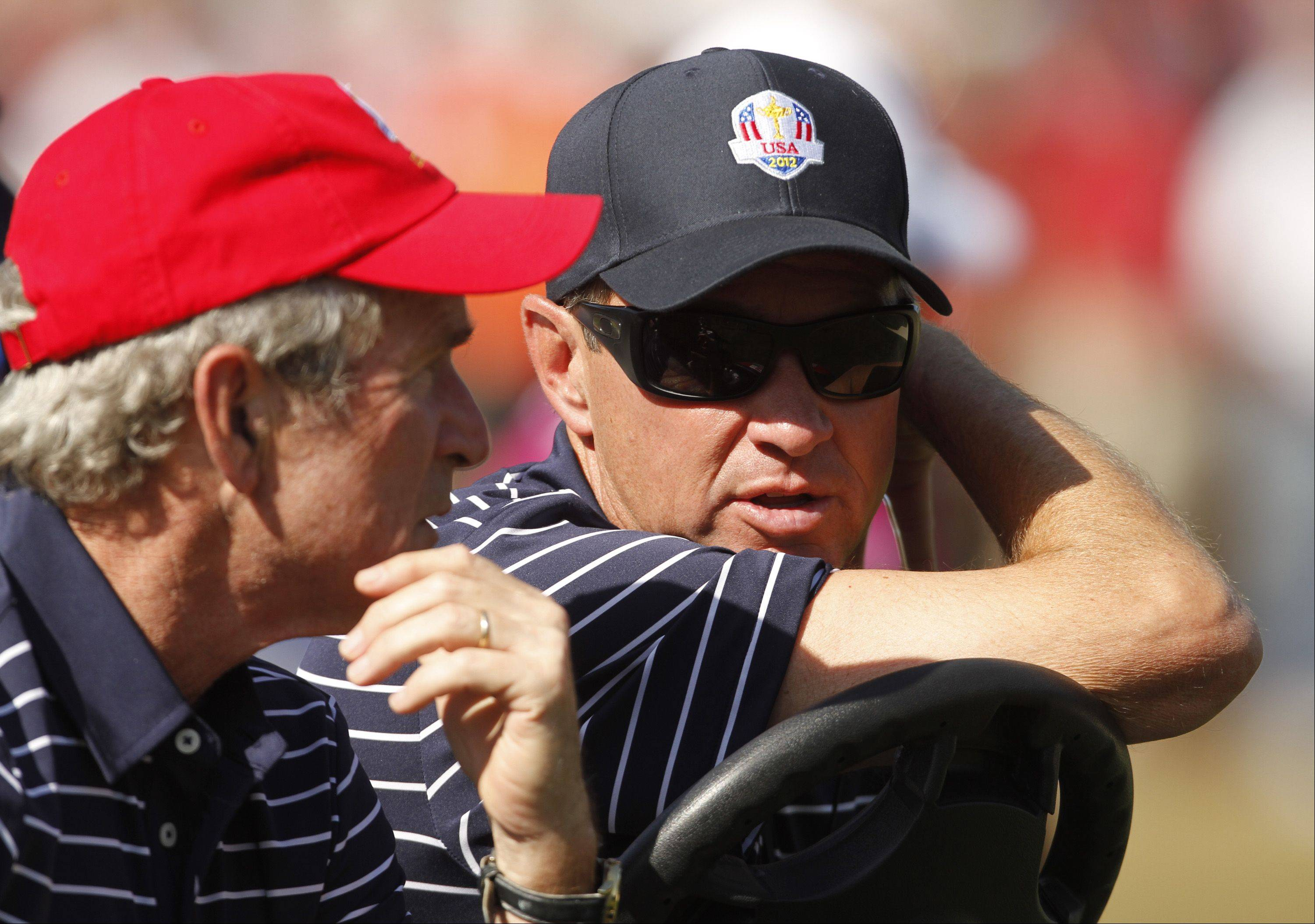 Team USA captain Davis Love III chats with President George W. Bush during the afternoon fourball matches at Medinah Country Club. Bush's father also took in the Ryder Cup matches.