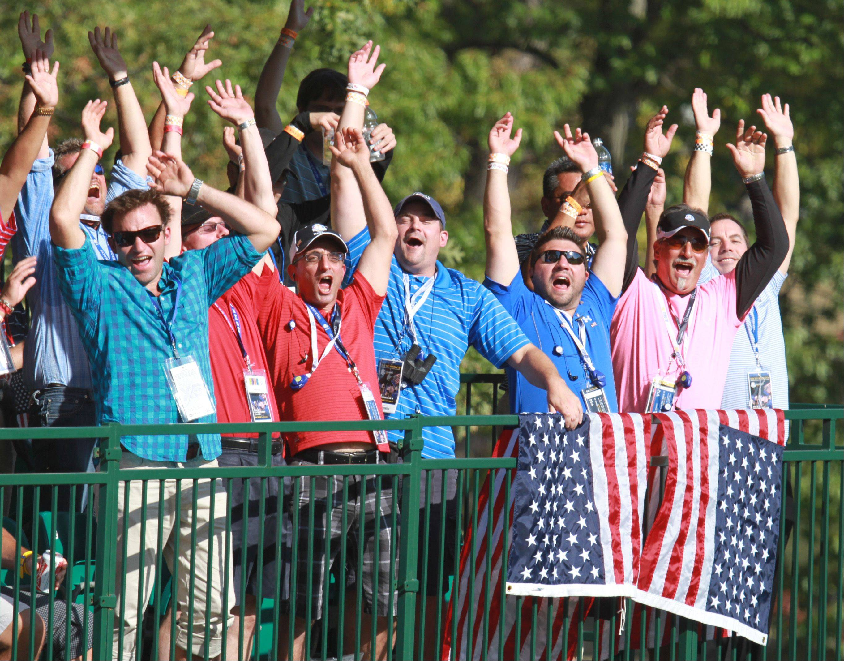 Ryder Cub fans watching the action on the No. 12 green at Medinah Country Club go crazy for Team USA Saturday afternoon.