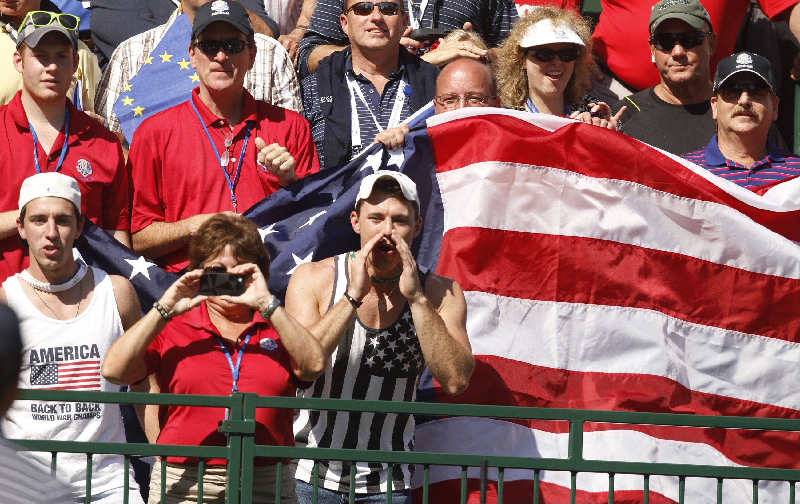 Patriotic fans scream for their teams during the Saturday afternoon Ryder Cup matches at Medinah County Club. Players and national media have praised the Medinah crowds for their sportsmanship and enthusiasm.