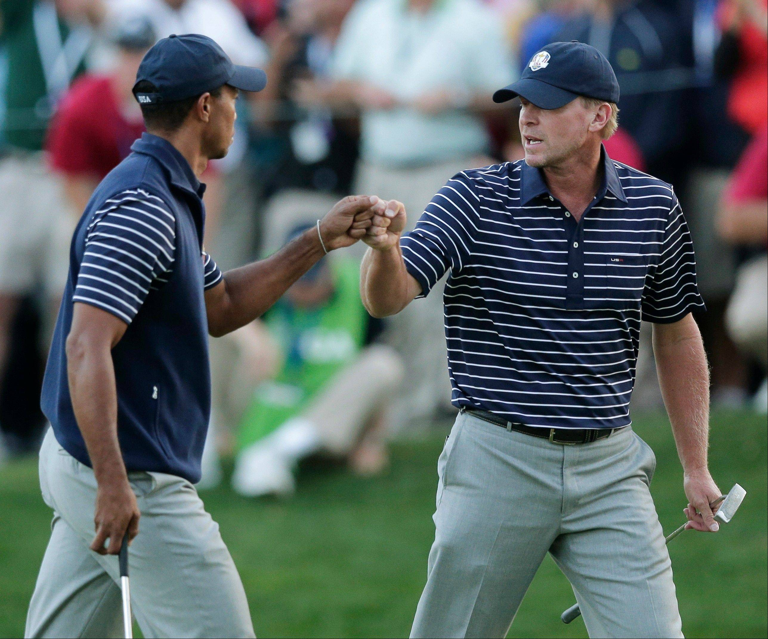 USA's Tiger Woods and Steve Stricker celebrate after winning the 16th hole during their fourball match Saturday at the Ryder Cup Saturday. Despite a rally, they lost their third straight match at Medinah.