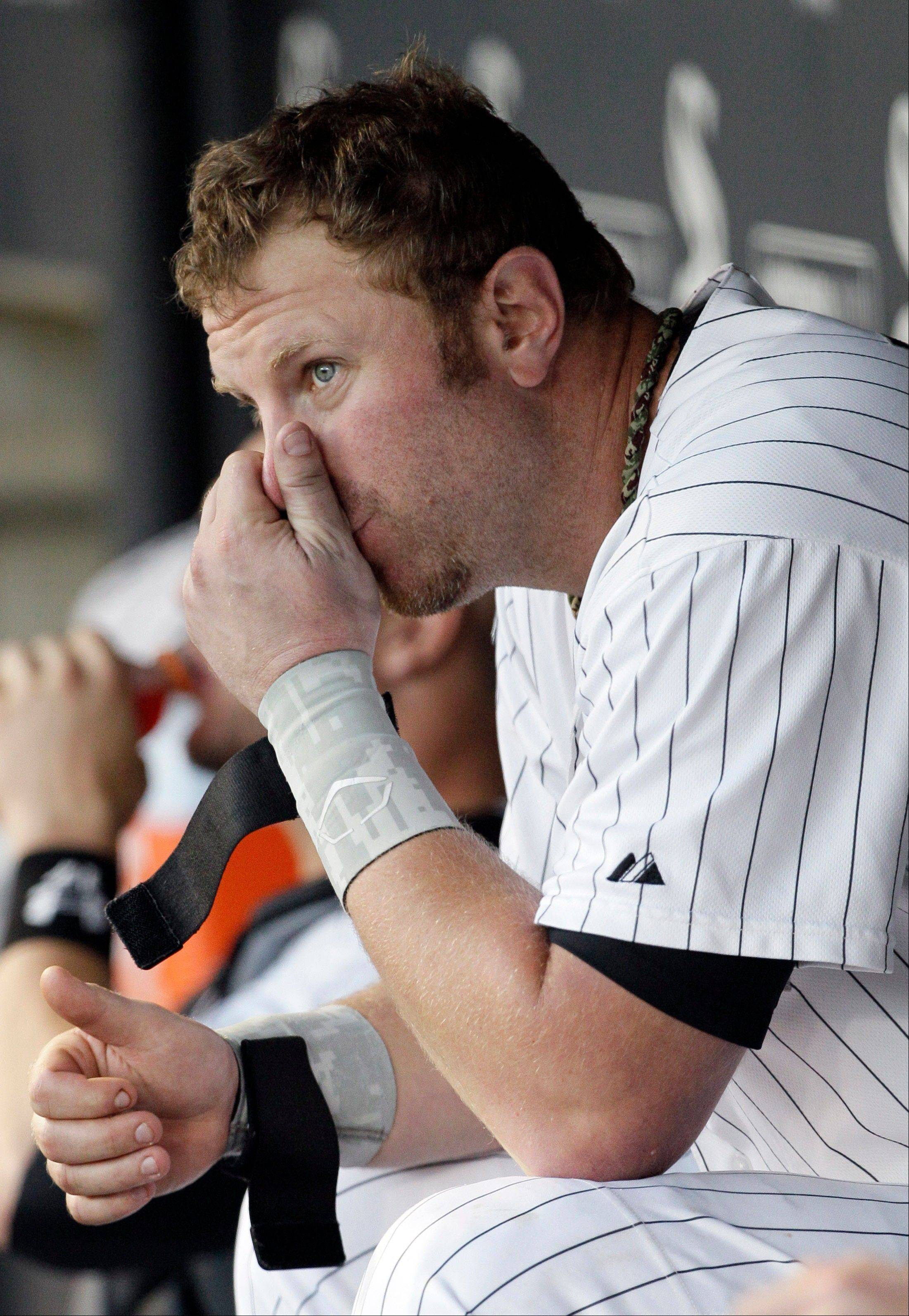Adam Dunn watches his White Sox teammates play against the Tampa Bay Rays Saturday during the eighth inning. The Rays won 10-4.