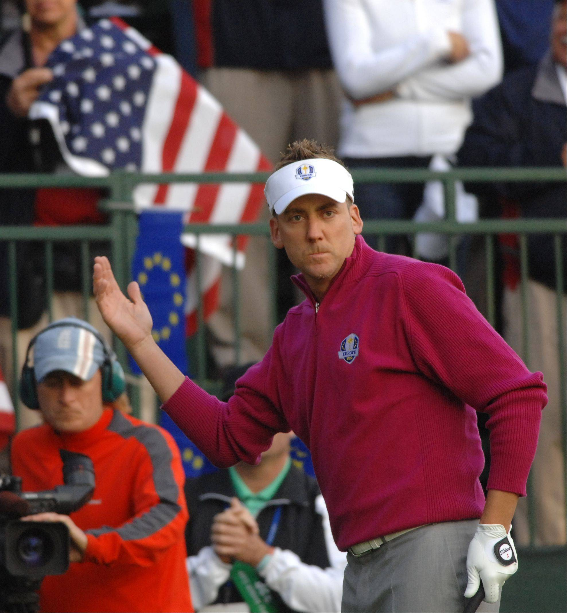 Ian Poulter of Team Europe tries to get the crowd before taking his tee shot Saturday morning during Day 2 of the 2012 Ryder Cup at Medinah Country Club. Poulter later said his heart rate went from 100 to 110 after firing up the pro-USA crowd.