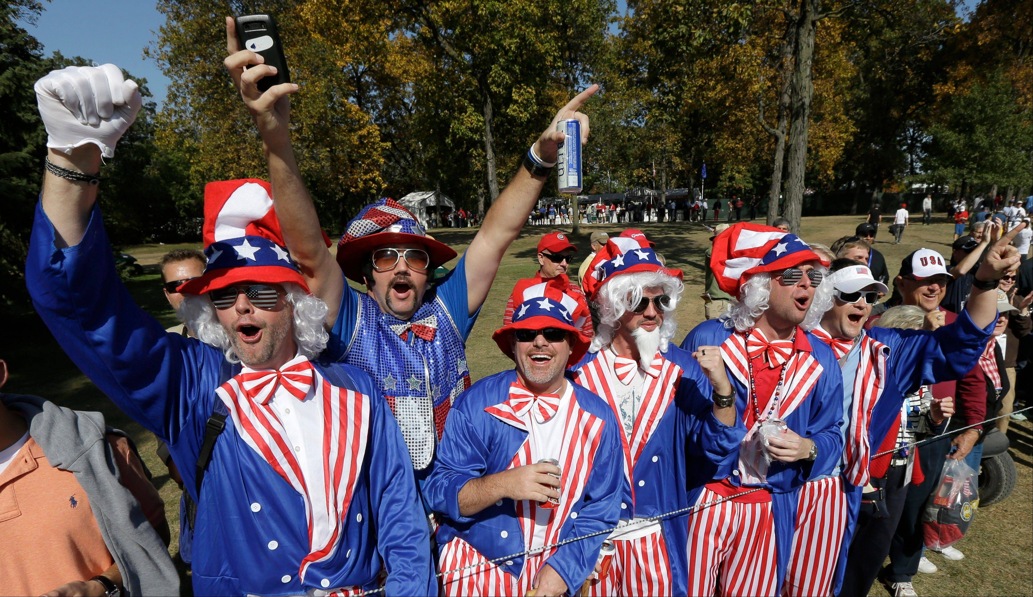 Fans cheer on the 16th hole during a foursomes match at the Ryder Cup on Saturday.