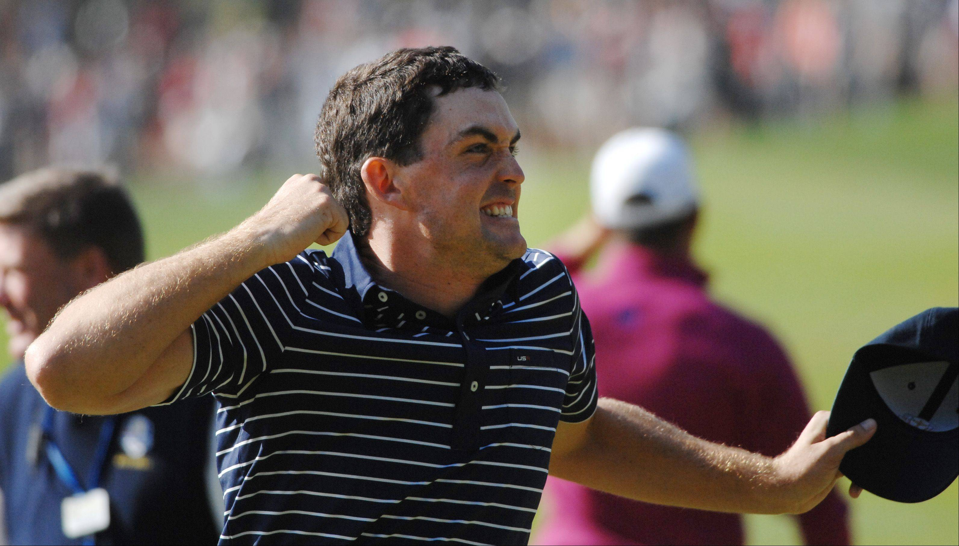 Keegan Bradley reacts to his team's win on the 12th hole of foursome play Saturday during the Ryder Cup matches.