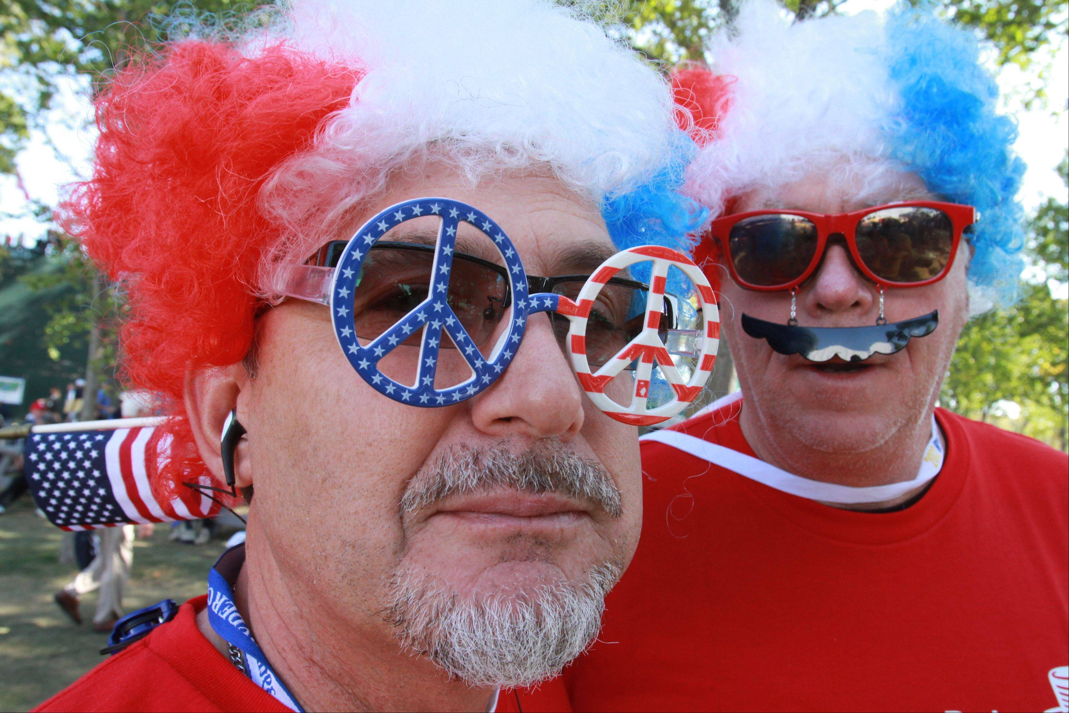 Greg Short, formerly of Peoria and now living in California, along with his friend David Jones of California, show their US spirit Saturday morning during day 2 of the 2012 Ryder Cup at Medinah Country Club.