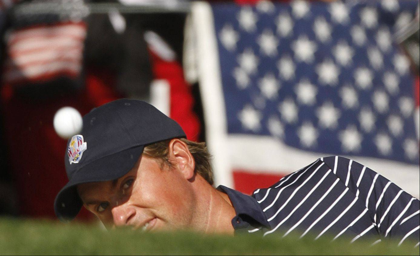 Webb Simpson chips on to the 14th green Saturday morning during day 2 of the 2012 Ryder Cup at Medinah Country Club.