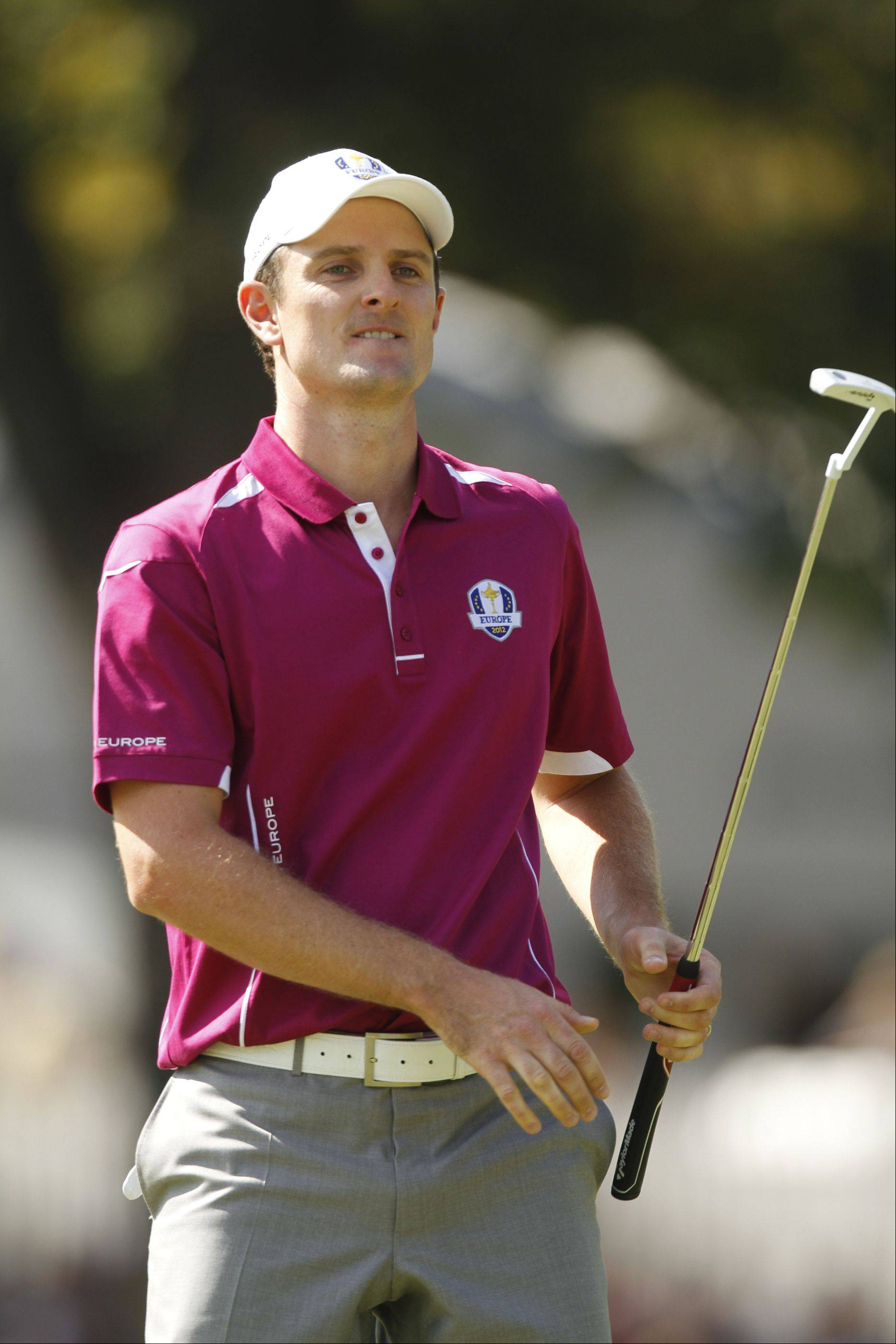Justin Rose reacts after missing a birdie putt on the 18th hole Saturday morning during day 2 of the 2012 Ryder Cup at Medinah Country Club.