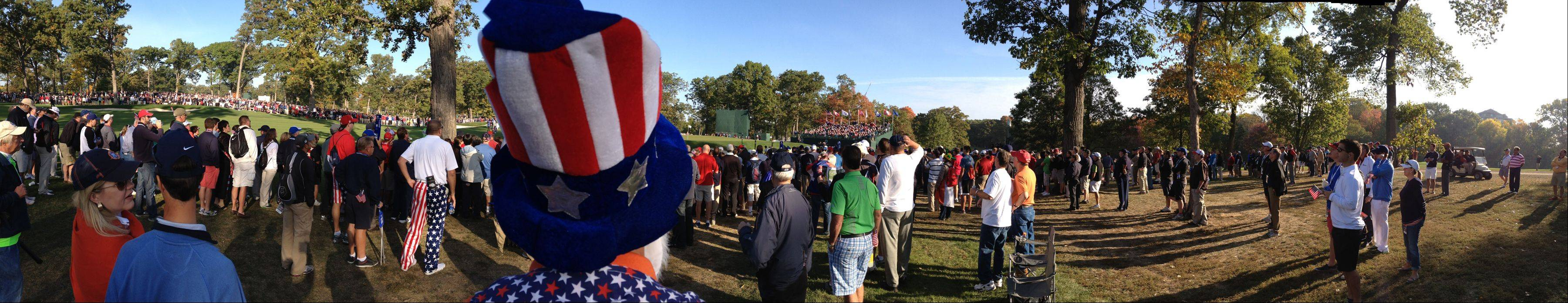 A panoramic photo of fans watching the action on the 7th hole Saturday morning during day 2 of the 2012 Ryder Cup at Medinah Country Club.